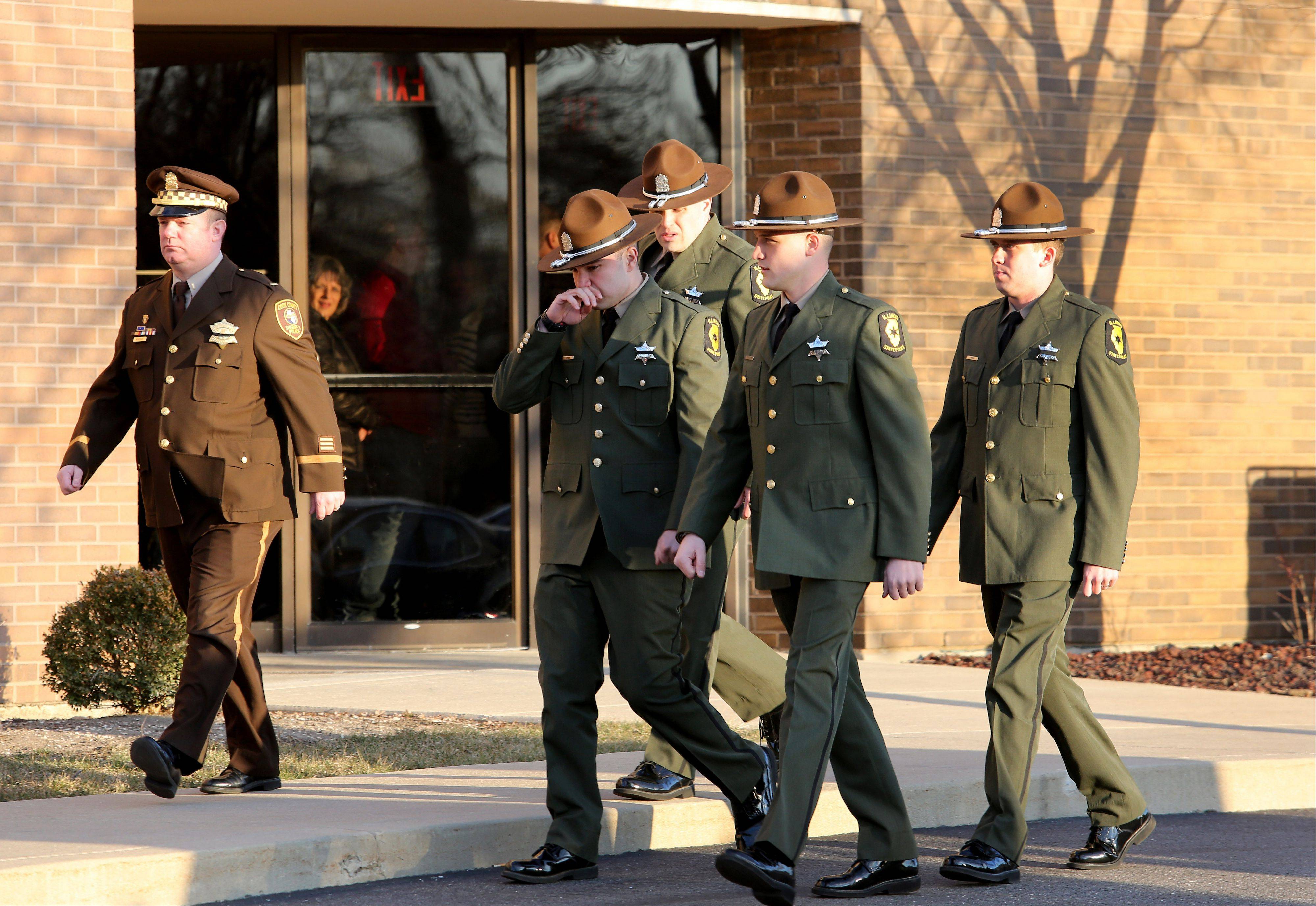 Mourners, including Illinois state troopers, arrive for the visitation of James Sauter at Moraine Valley Church in Palos Heights on Monday. He was an Illinois state trooper from Vernon Hills, who was killed early Friday morning on the job.