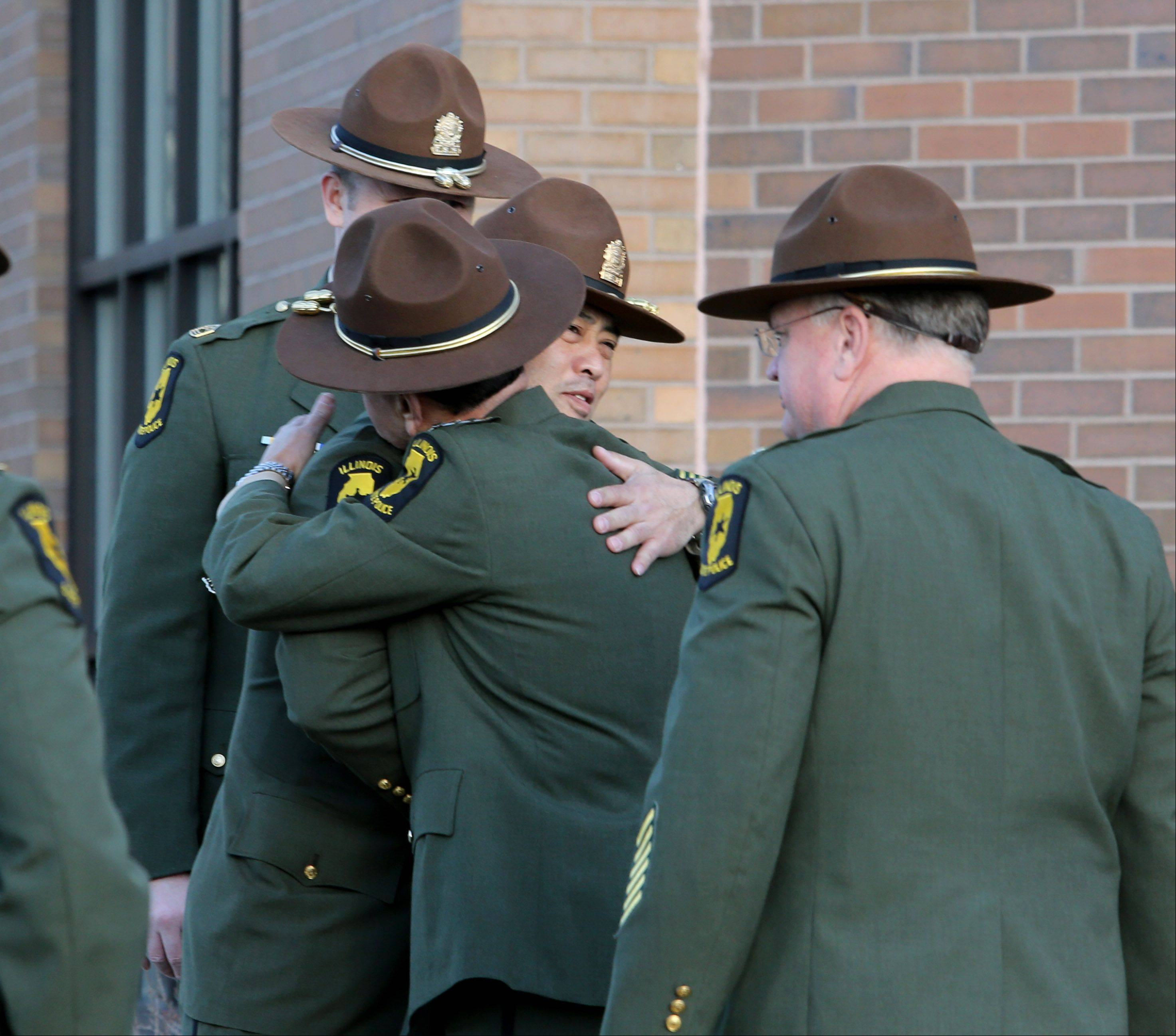 Illinois state troopers and other mourners gather for the visitation of James Sauter at Moraine Valley Church in Palos Heights on Monday. He was an Illinois state trooper from Vernon Hills, who was killed early Friday morning on the job.