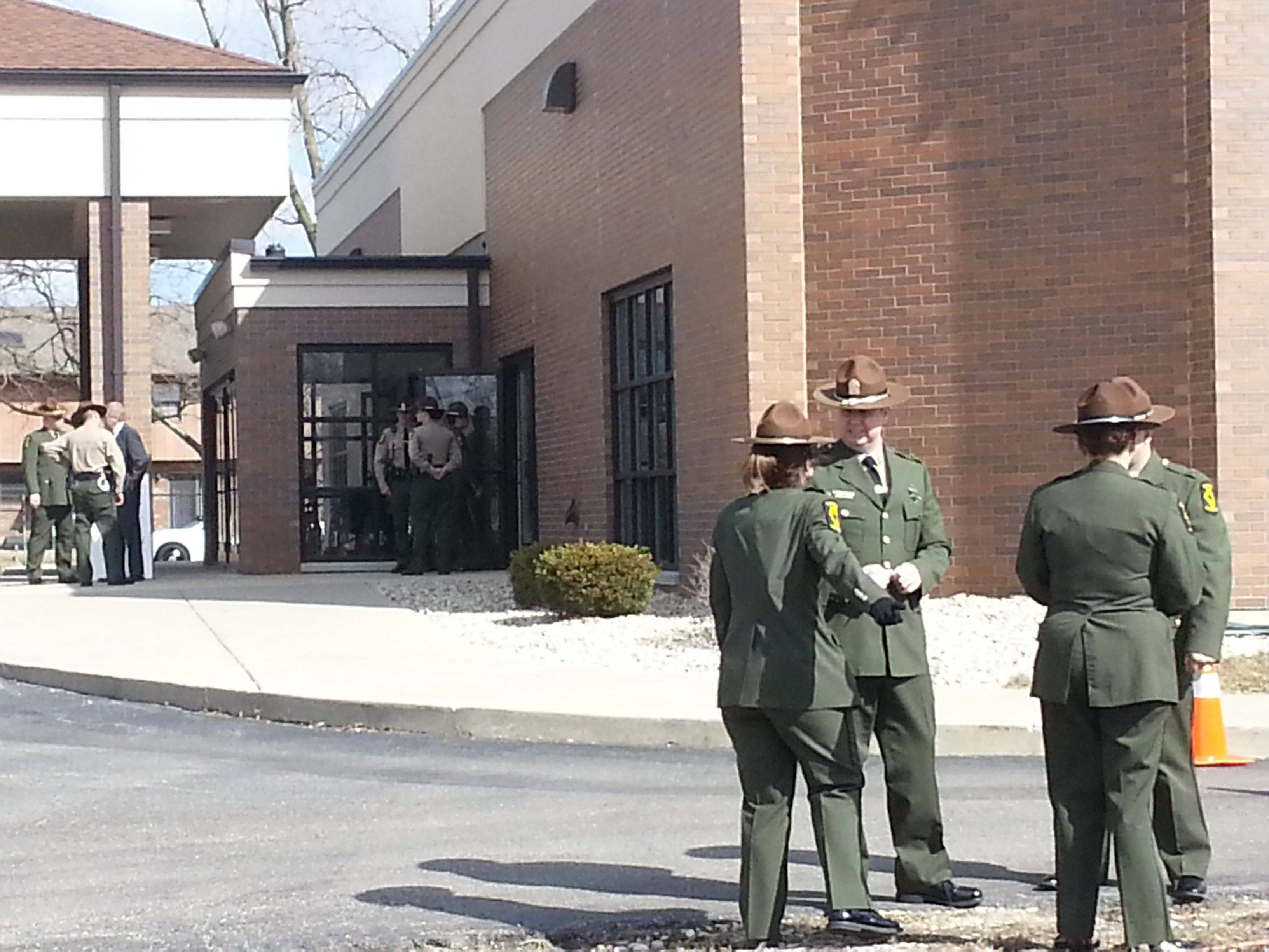 Illinois State Police stand outside Moraine Valley Church in Palos Heights Monday while attending a visitation for 28-year-old Illinois State Police trooper James Sauter, who was killed on duty last week.