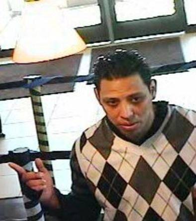 A surveillance photo shows the suspect in a bank robbery Monday morning in Glendale Heights.
