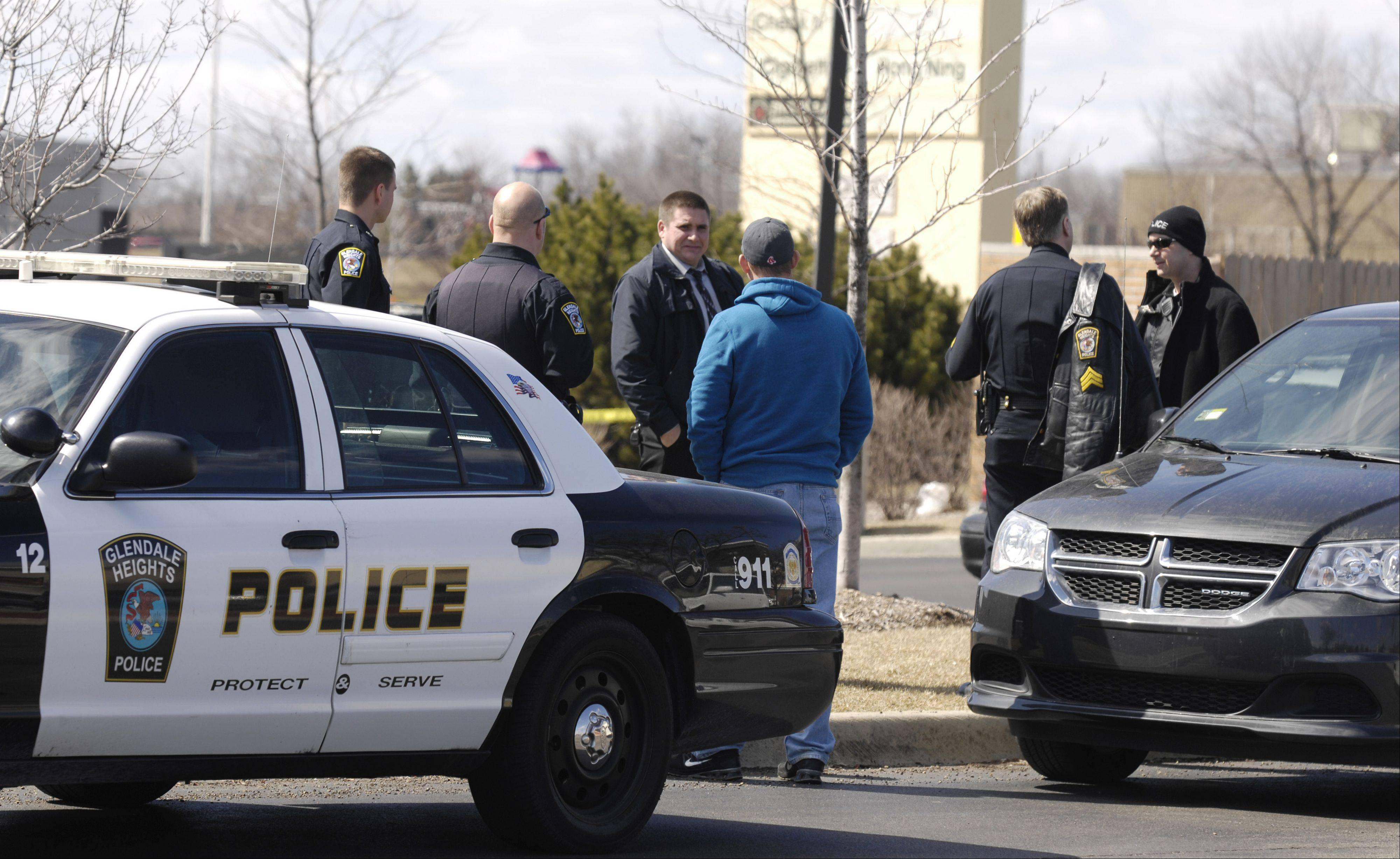Glendale Heights police investigate a bank robbery Monday at the Chase Bank branch at Army Trail and Bloomingdale roads. Authorities said the robber told a teller he had a weapon, but did not actually display one.