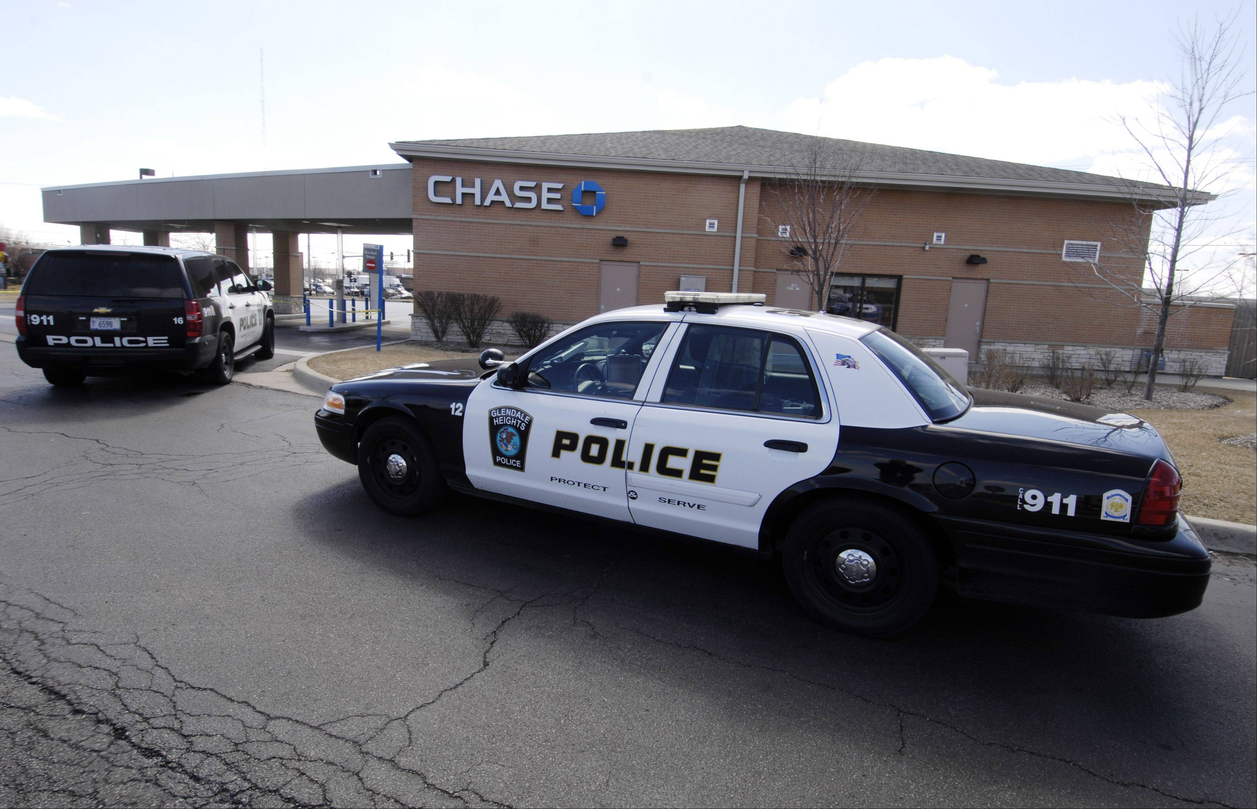 Glendale Heights police investigate a bank robbery Monday at the Chase Bank branch at Army Trail and Bloomingdale roads.
