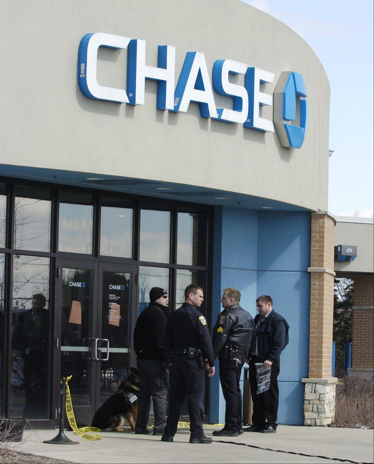 Glendale Heights police respond to a bank robbery Monday at the Chase Bank branch at Army Trail and Bloomingdale roads.