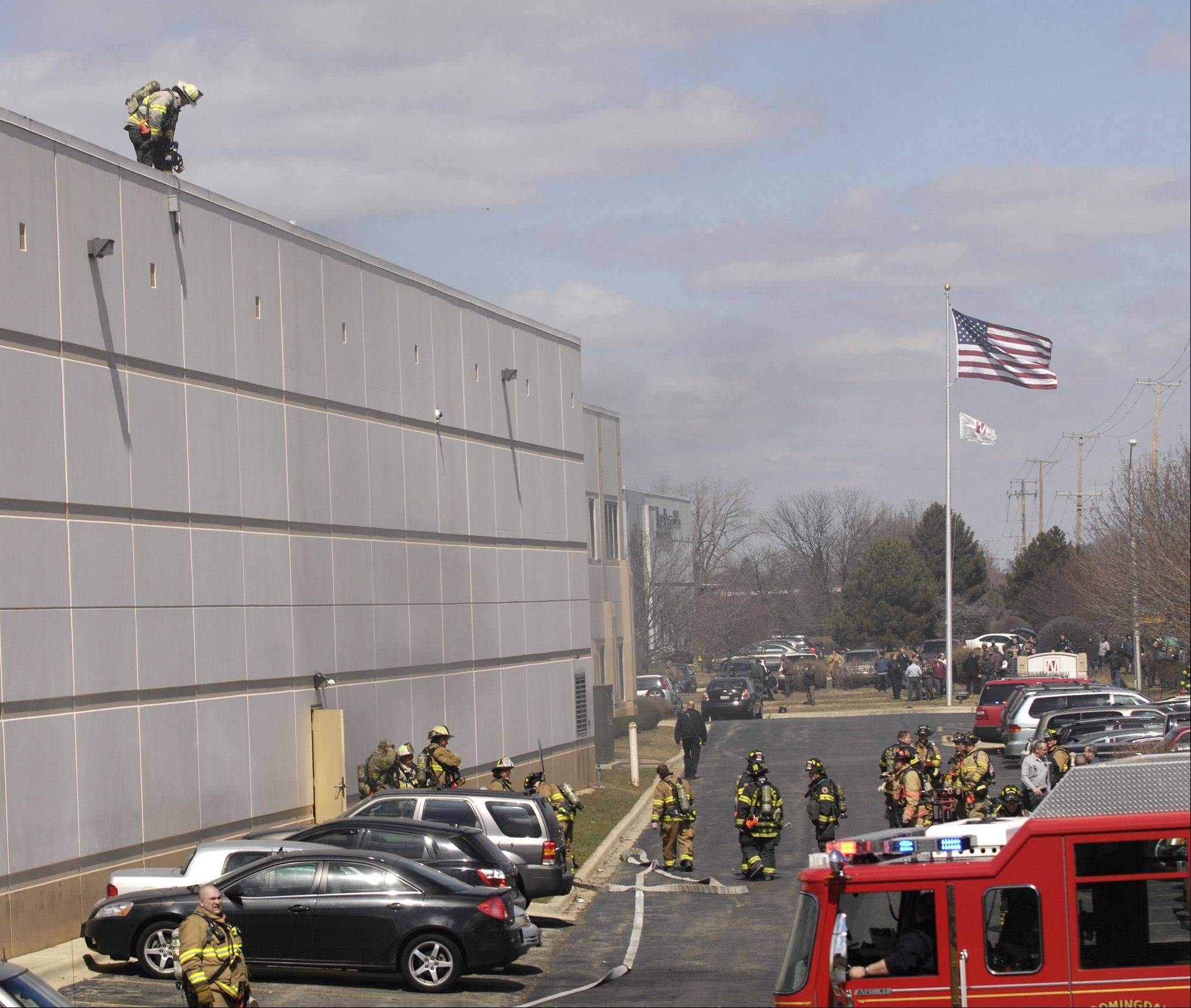 Firefighters work Monday on the roof of Northstar Metal Products Inc. in Glendale Heights.