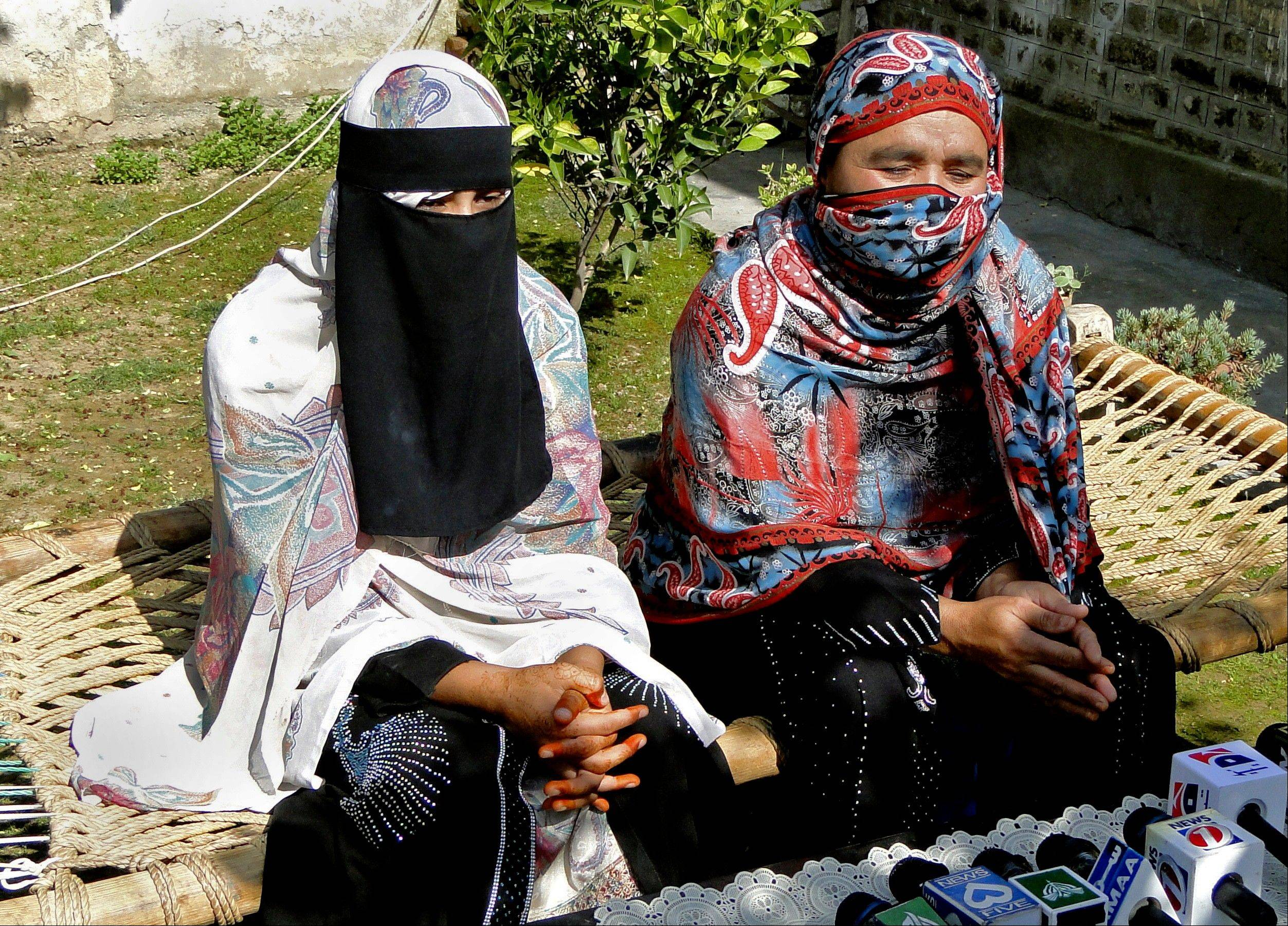 Badam Zari, right, addresses a news conference with her sister in Khar, capital of Pakistani tribal area of Bajur on Monday. Zari, a 40-year-old Pakistani housewife, has made history by becoming the first woman to run for parliament from the country's northwest tribal region, a highly conservative area that is a haven for Islamist militants.