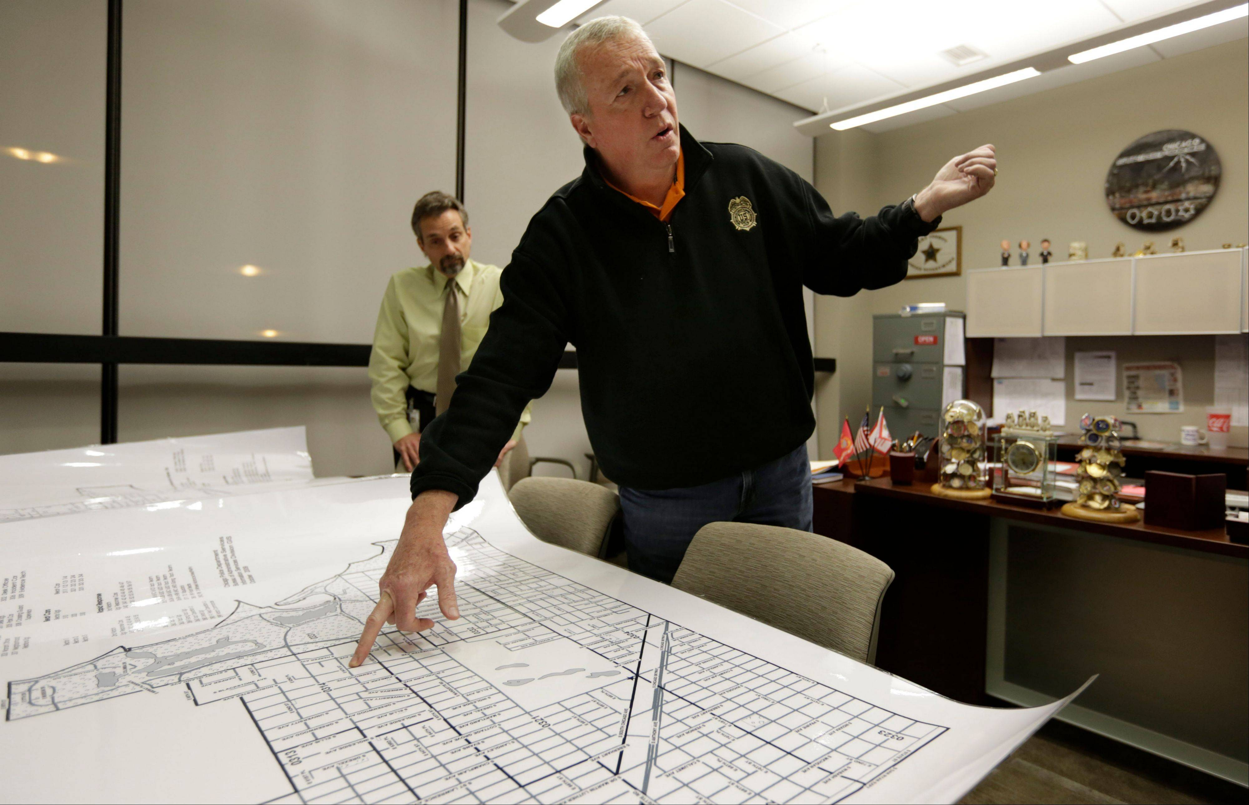 Jack Riley, head of the Drug Enforcement Administration in Chicago, points out local Mexican drug cartel problem areas on a map in the new interagency Strike Force office in Chicago. Looking on is DEA agent Vince Balbo. The ruthless syndicates have long been the nation's No. 1 supplier of illegal drugs, but in the past, their operatives rarely ventured beyond the border. A wide-ranging Associated Press review of federal court cases and government drug-enforcement data, plus interviews with many top law enforcement officials, indicate the groups have begun deploying agents from their inner circles to the U.S.