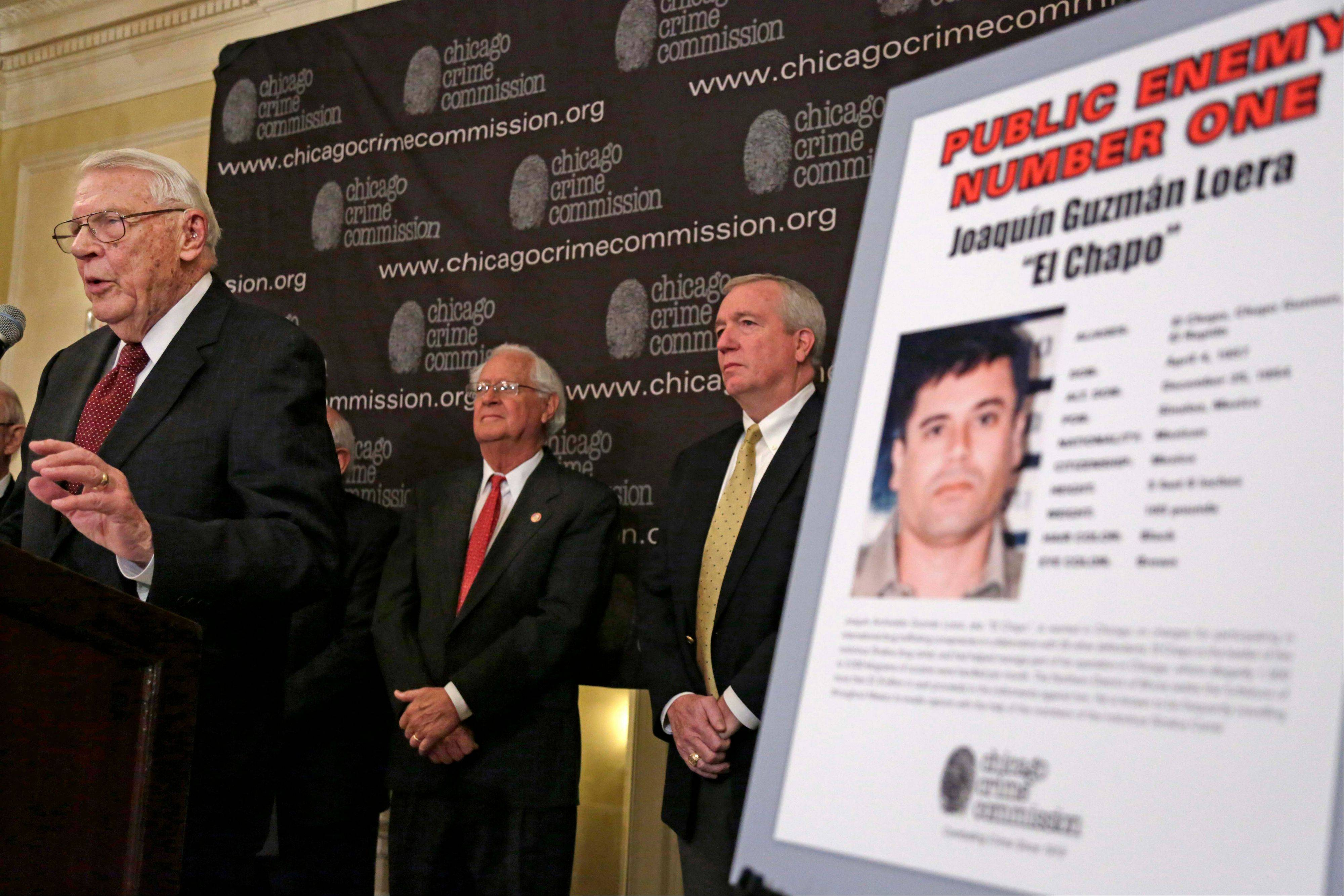 "Art Bilek, executive vice president of the Chicago Crime Commission, left, announces that Joaquin ""El Chapo"" Guzman, a drug kingpin in Mexico, has been named Chicago's Public Enemy No. 1, during a news conference in Chicago. Looking on is Jack Riley, right, head of the Drug Enforcement Administration in Chicago and Peter Bensinger, former Administrator of the United States DEA."