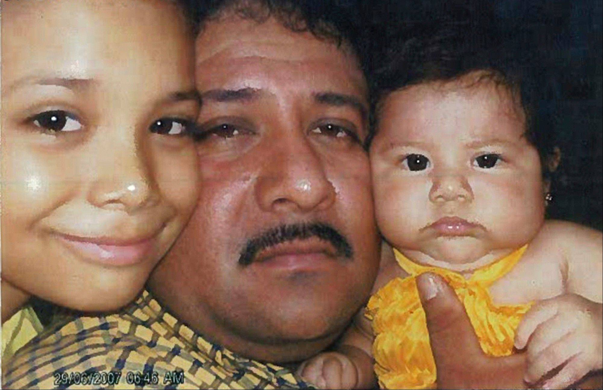 This photo dated in 2007 from federal court documents provided by attorneys for Jose Gonzales-Zavala shows Gonzales-Zavala with two of his children. Prosecutors say Gonzales-Zavala was a member of the La Familia cartel, based in southwestern Mexico, and dispatched to the Chicago area to oversee one of the cartel's lucrative trafficking cells. His defense team entered the photograph into evidence during the sentence stage of his case in arguing for leniency. In 2011, he was sentenced to 40 years in prison by a federal judge in Chicago.