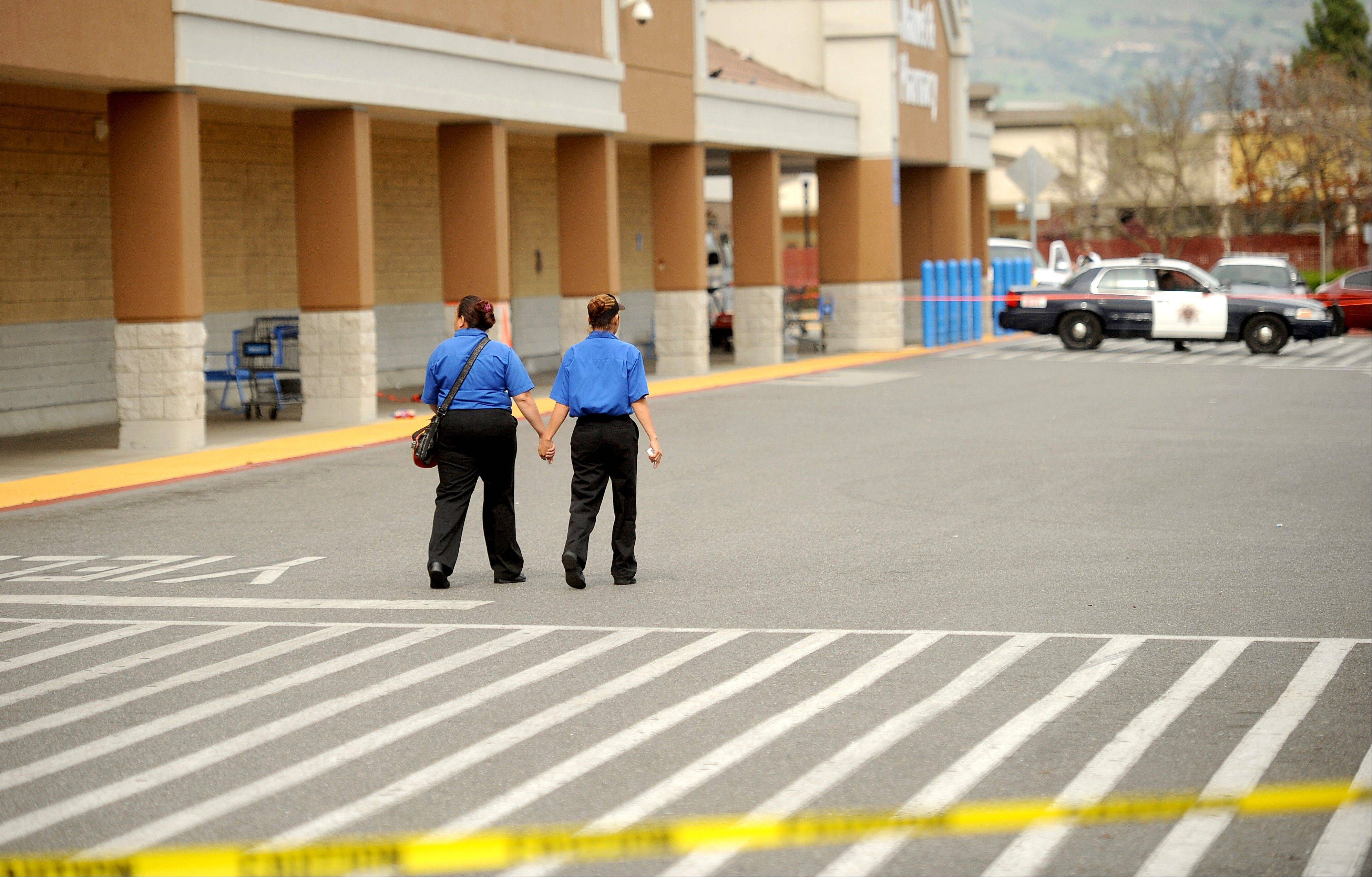 Unidentified women leave a San Jose, Calif., Wal-Mart after a motorist drove through a store entrance and began assaulting shoppers on Sunday. Four people suffered injuries during the attack, according to a police spokesman.