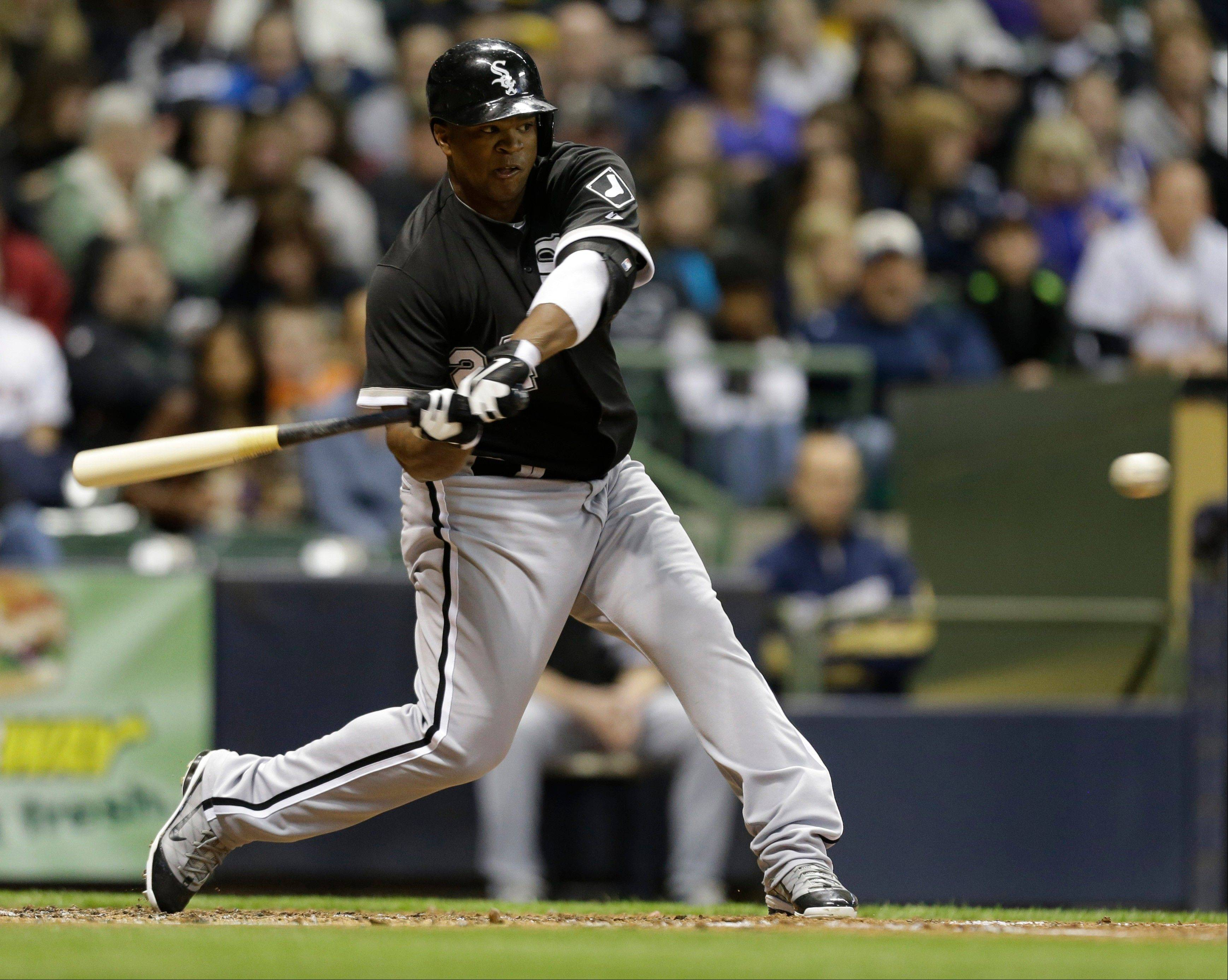 White Sox outfielder Dayan Viciedo hits a two-run double against the Milwaukee Brewers during the fourth inning of an exhibition baseball game Friday, March 29, 2013, in Milwaukee.
