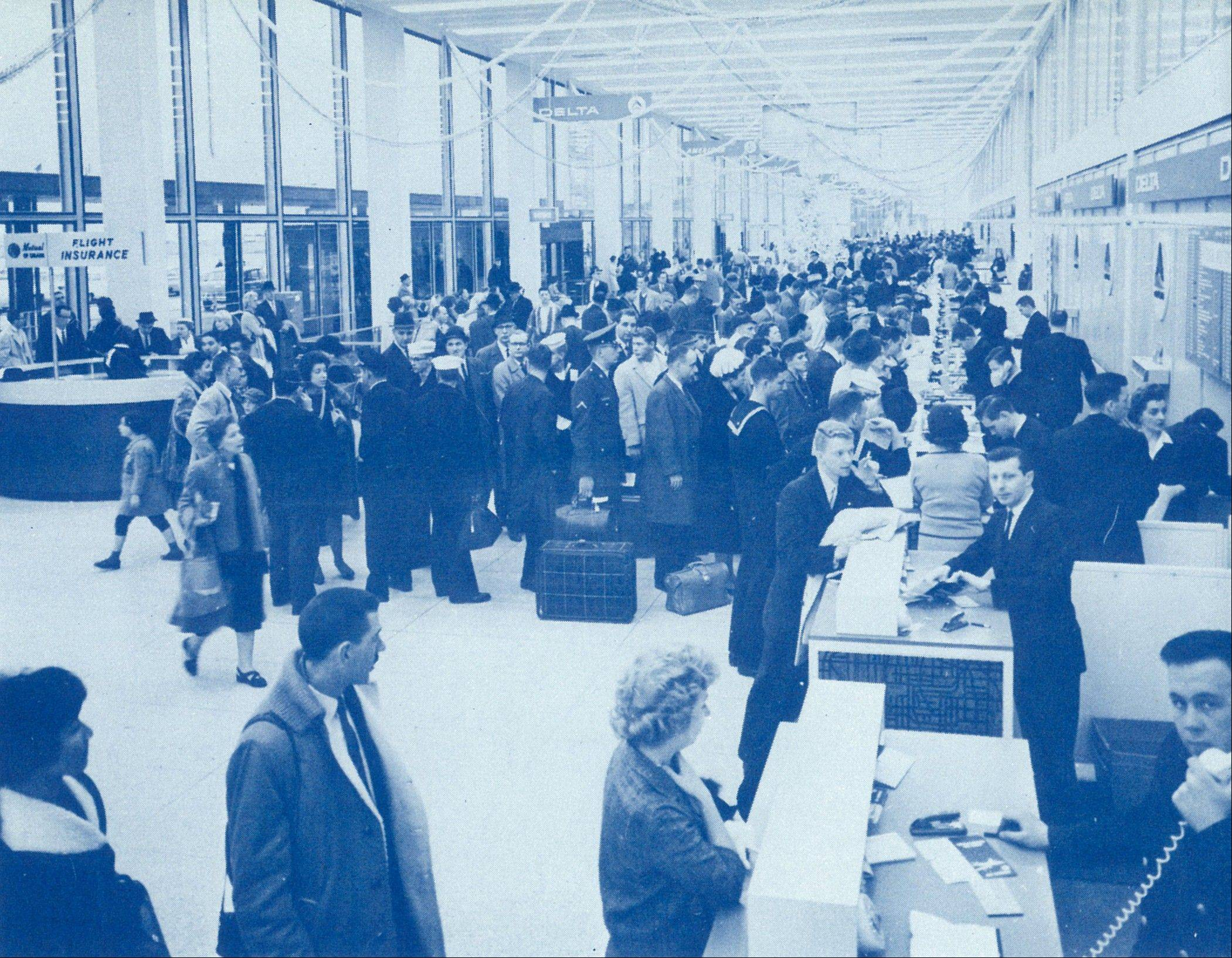 Passengers check in at O'Hare's Terminal 1 in 1962, a year before the airport was formally dedicated.
