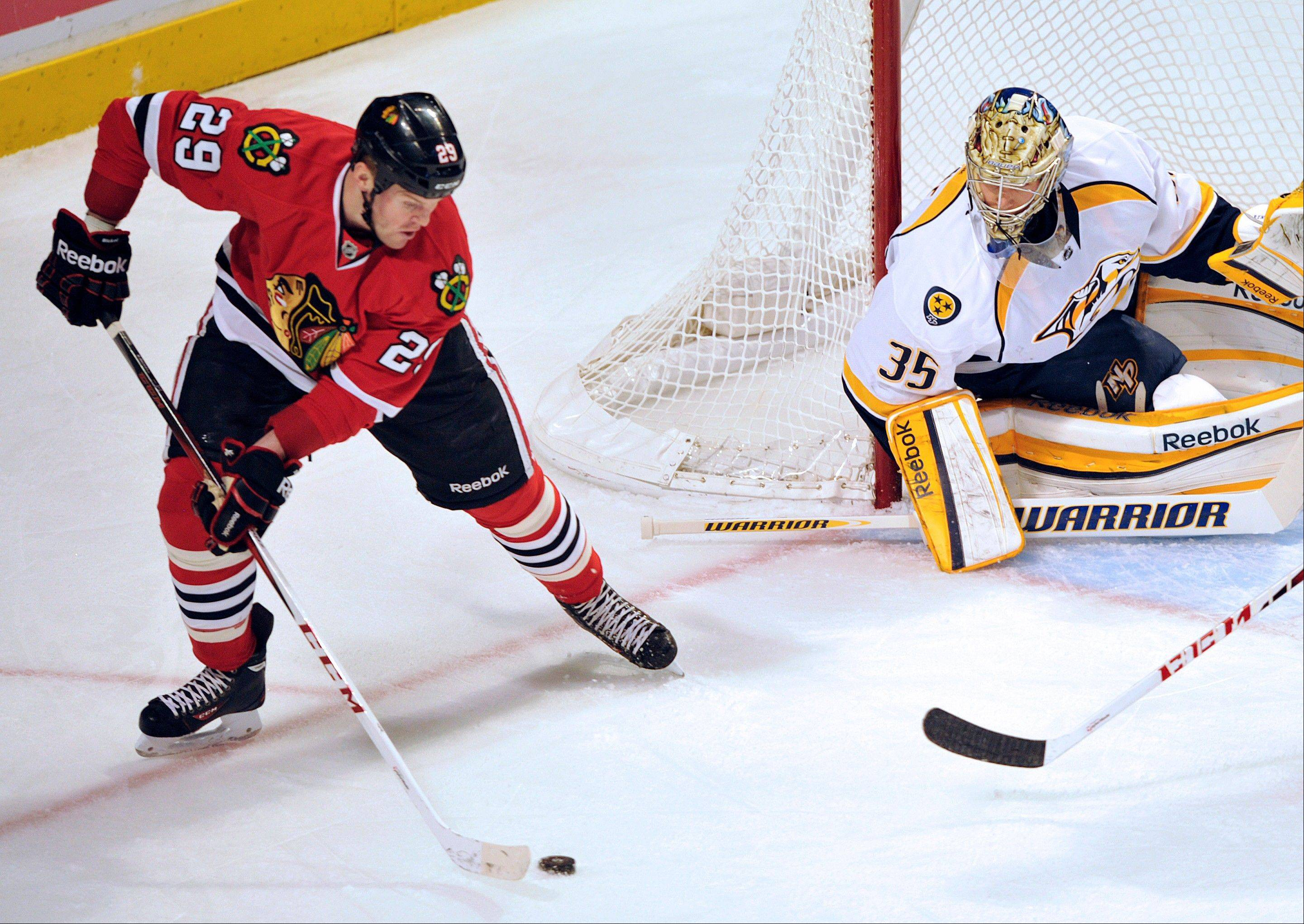 Chicago Blackhawks' Bryan Bickell (29) looks to shoot the puck on Nashville Predators' Pekka Rinne (35) during the first period.