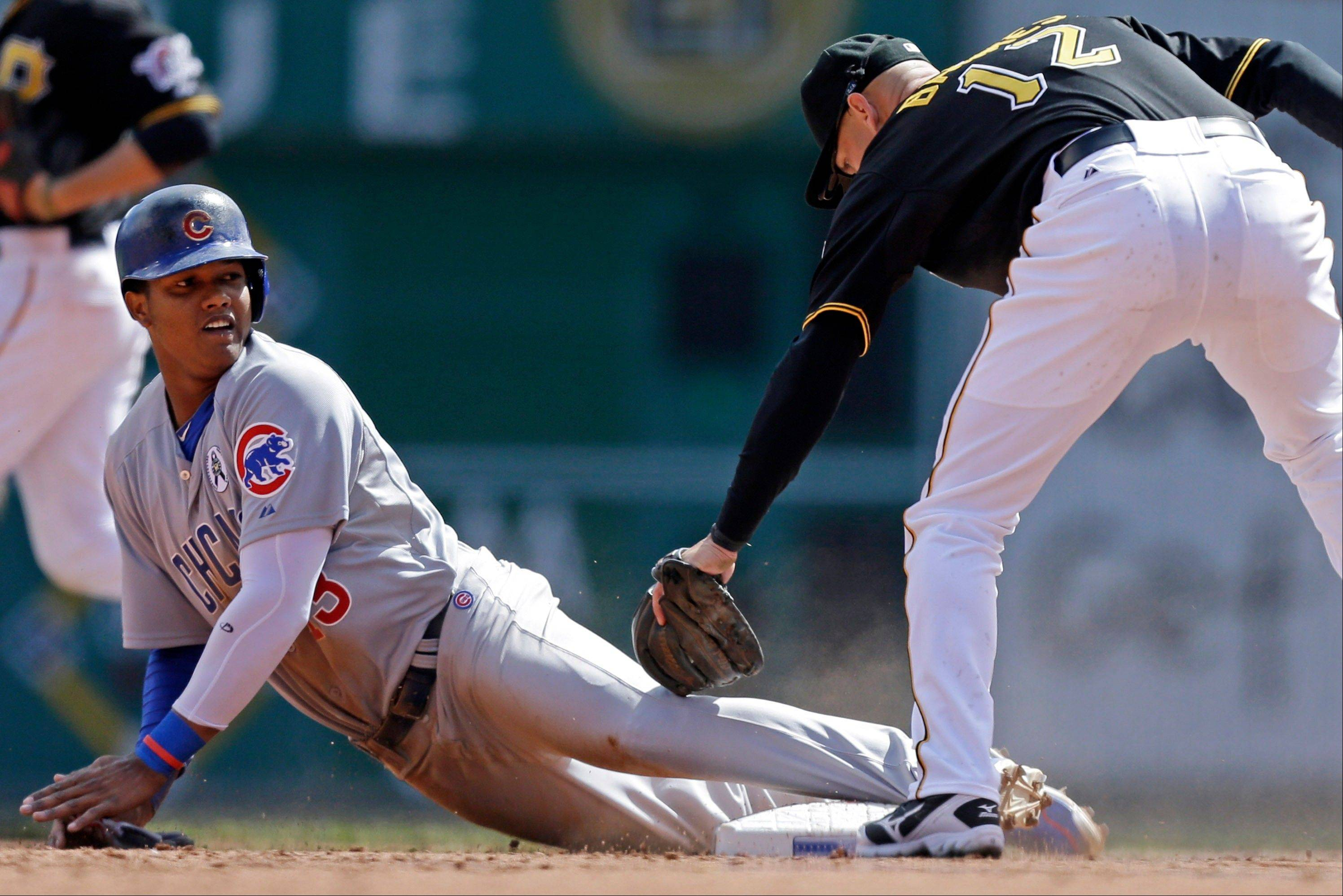Starlin Castro (13) steals second base as Pittsburgh Pirates shortstop Clint Barmes (12) applies the late tag during the third inning of a baseball game in Pittsburgh Monday, April 1, 2013.