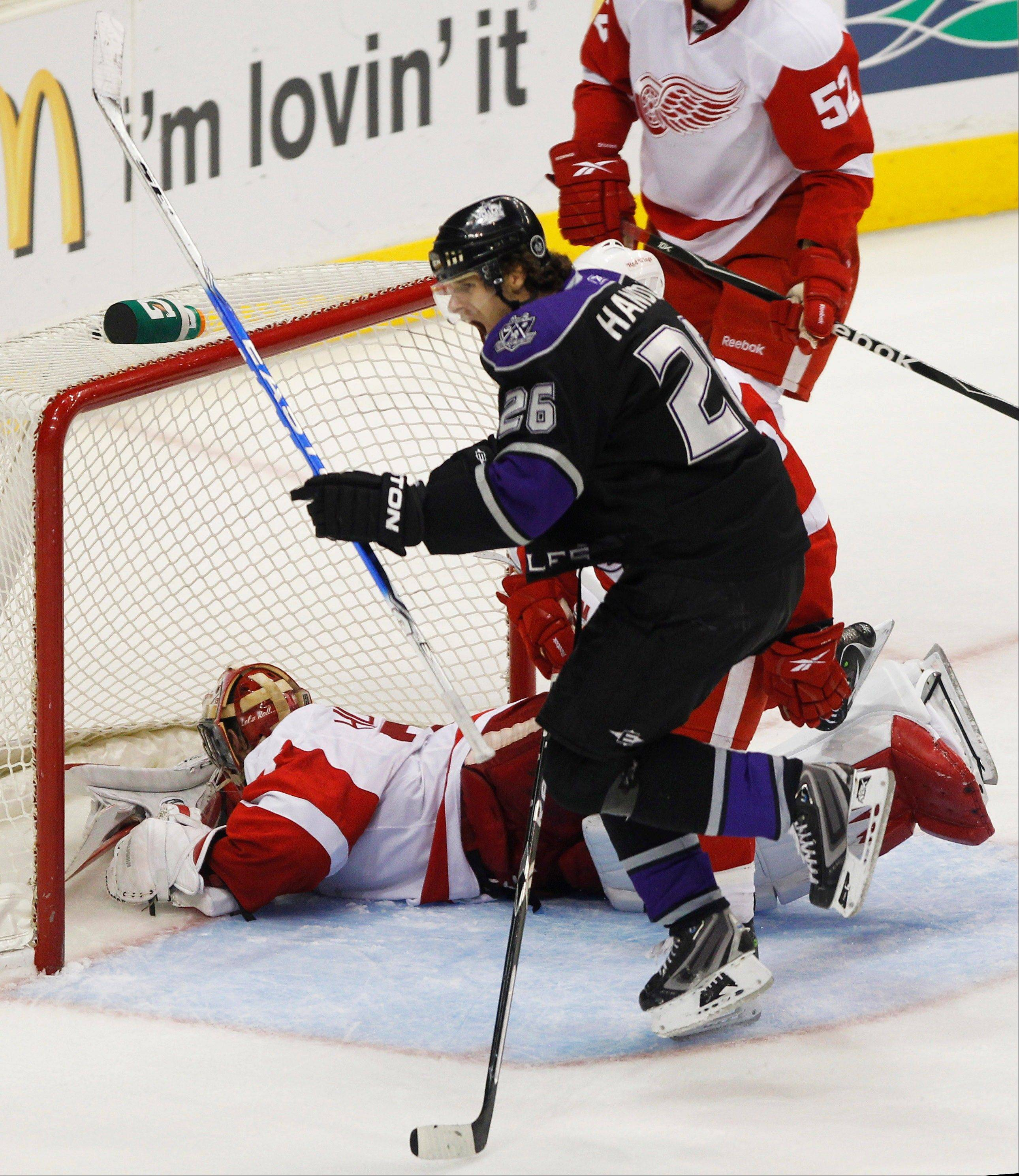 Center Michal Handzus, then with the Los Angeles Kings, celebrates his game winning goal past Detroit Red Wings goalie Jimmy Howard. The Blackhawks acquired Handzus in a trade with the San Jose Sharks.