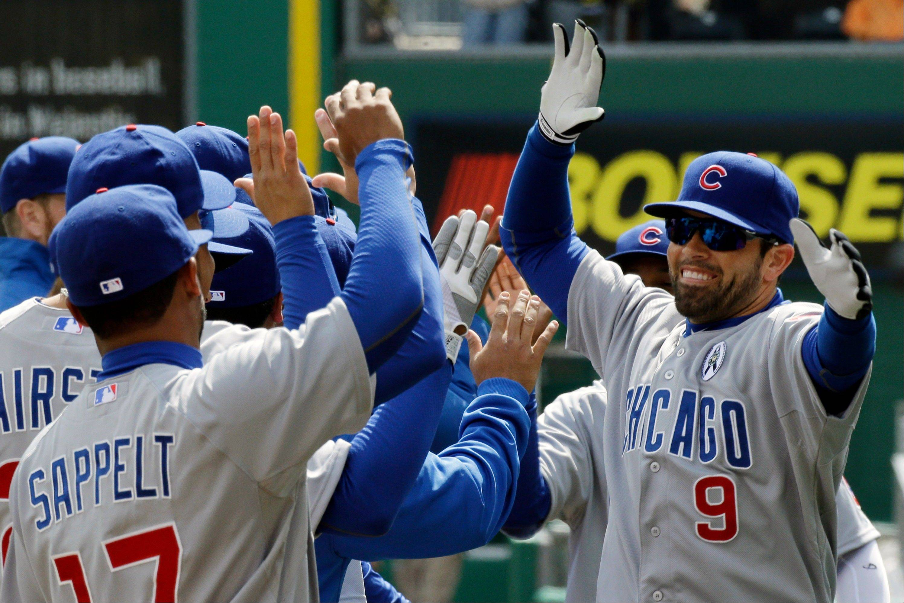 Chicago Cubs right fielder David DeJesus celebrates with teammates after being introduced before the game.