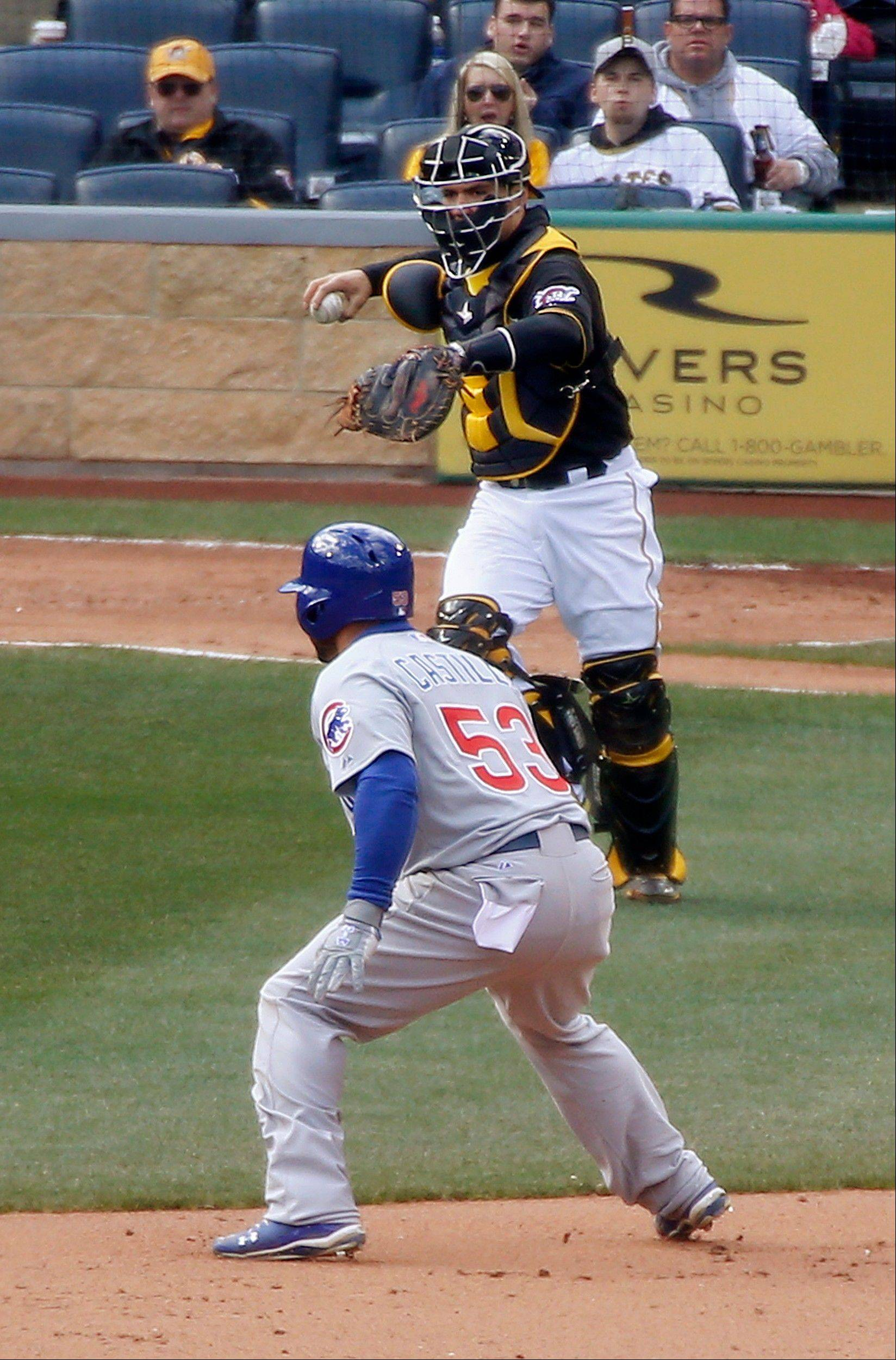 Pittsburgh Pirates catcher Russell Martin, top, looks to throw as Chicago Cubs' Welington Castillo is caught in a rundown after driving in teammate Nate Schierholtz in the sixth inning.