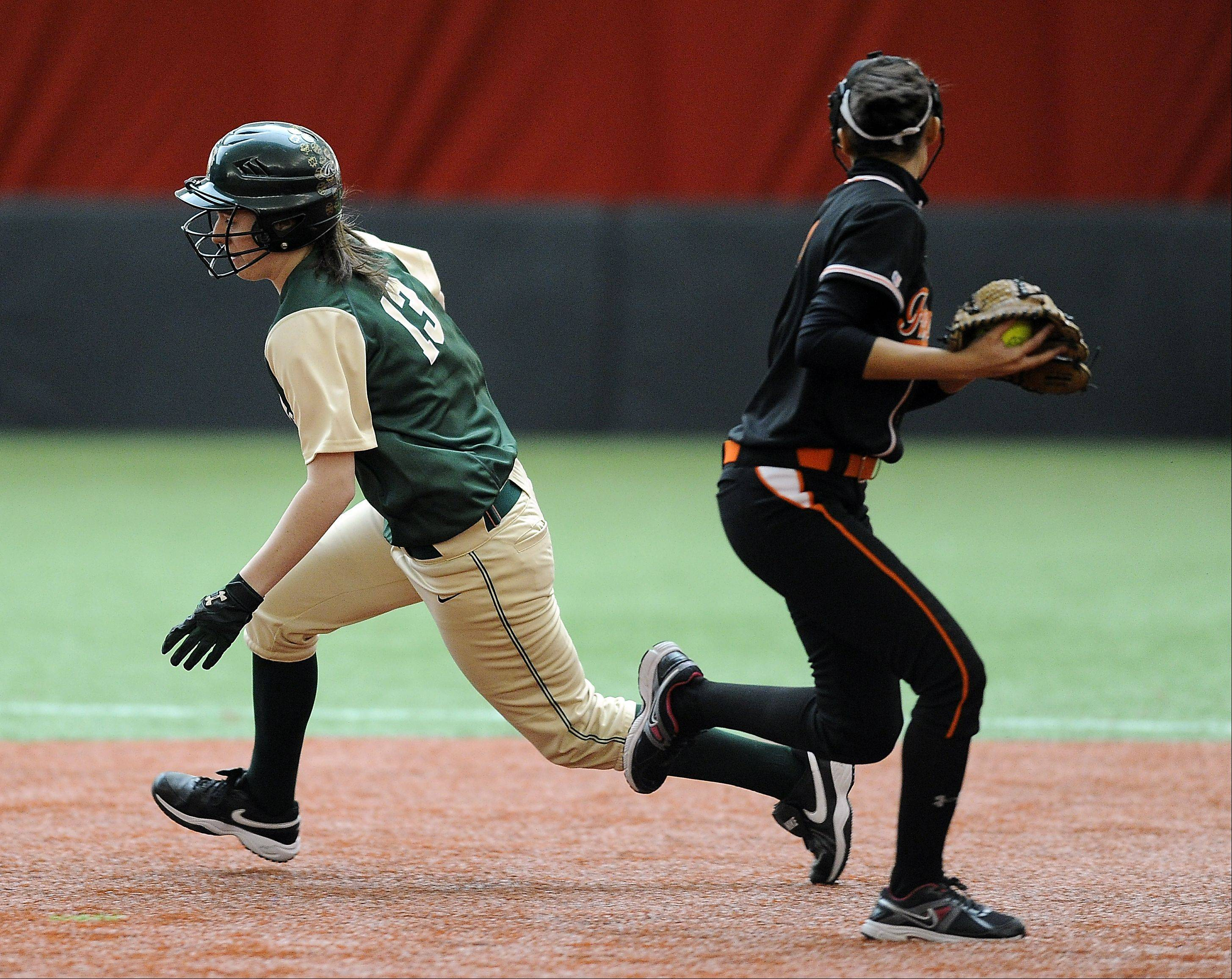 St. Edward's Ryann Scully steals second past Freeport's Jordan Flack in the first inning in Rosemont on Monday.
