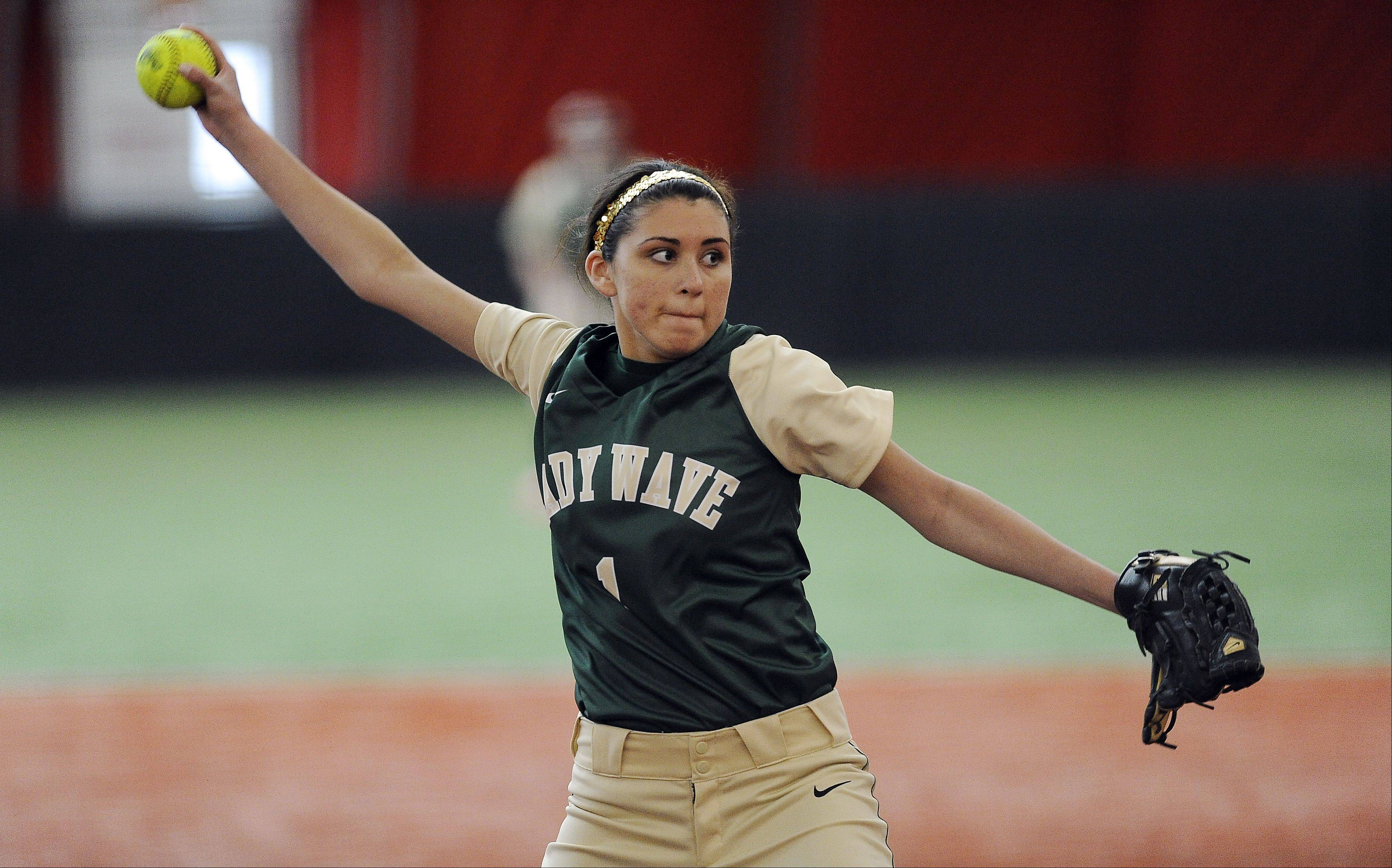 St. Edward sophomore pitcher Angela Zenteno fires one in against Freeport in Rosemont on Monday.