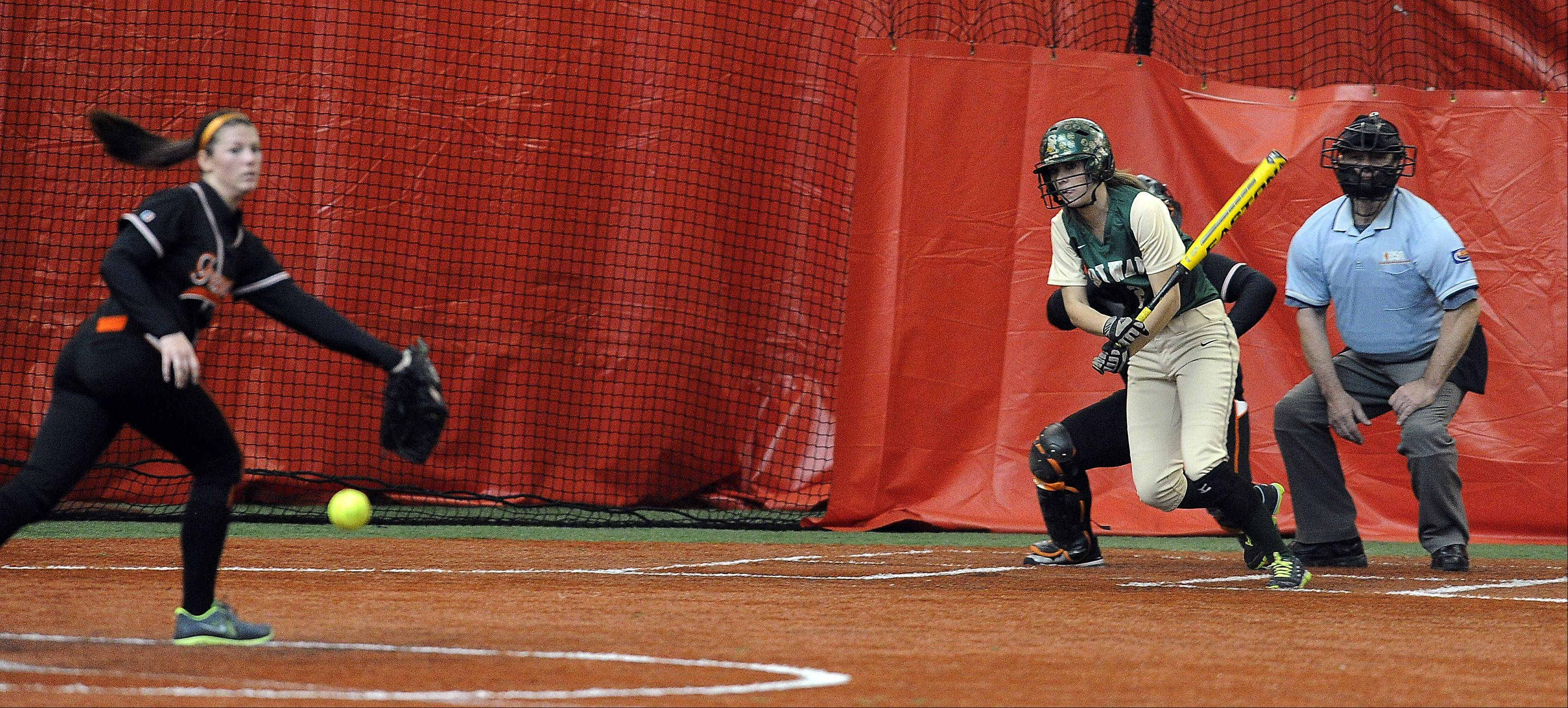 St. Edward's Kali Kossakowski drives one up the middle for an RBI single in Rosemont on Monday.