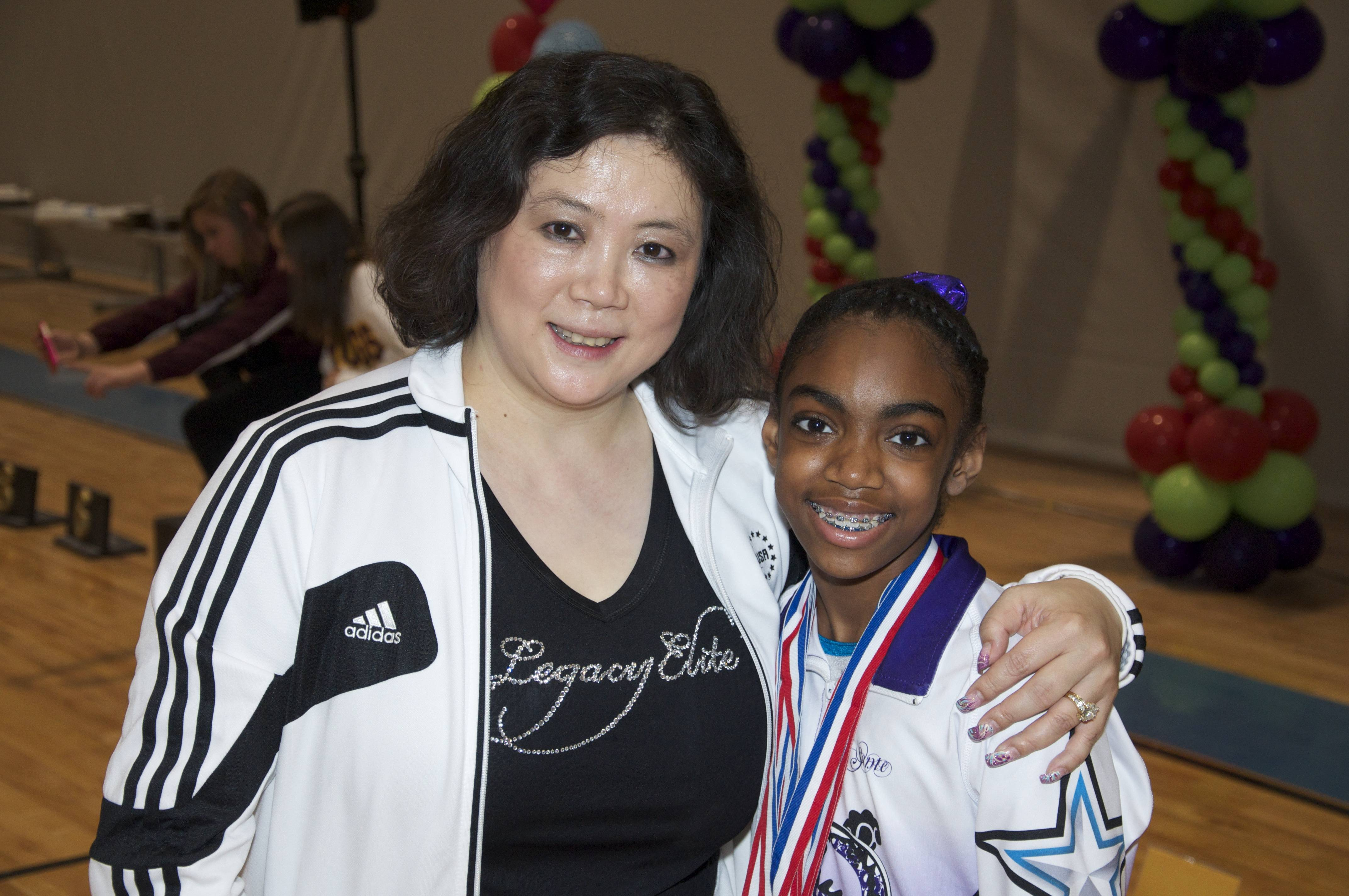 Sonte Turnage and her Coach Jiani Wu of Legacy Elite Gymnastics at the recent Illinois Level 8 State gymnastics meet in Bourbonnais, IL.