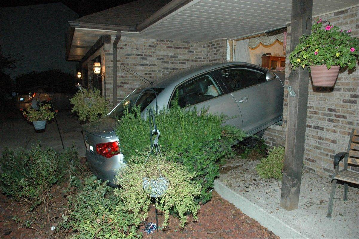 Naperville driver who hit house pleads guilty to DUI