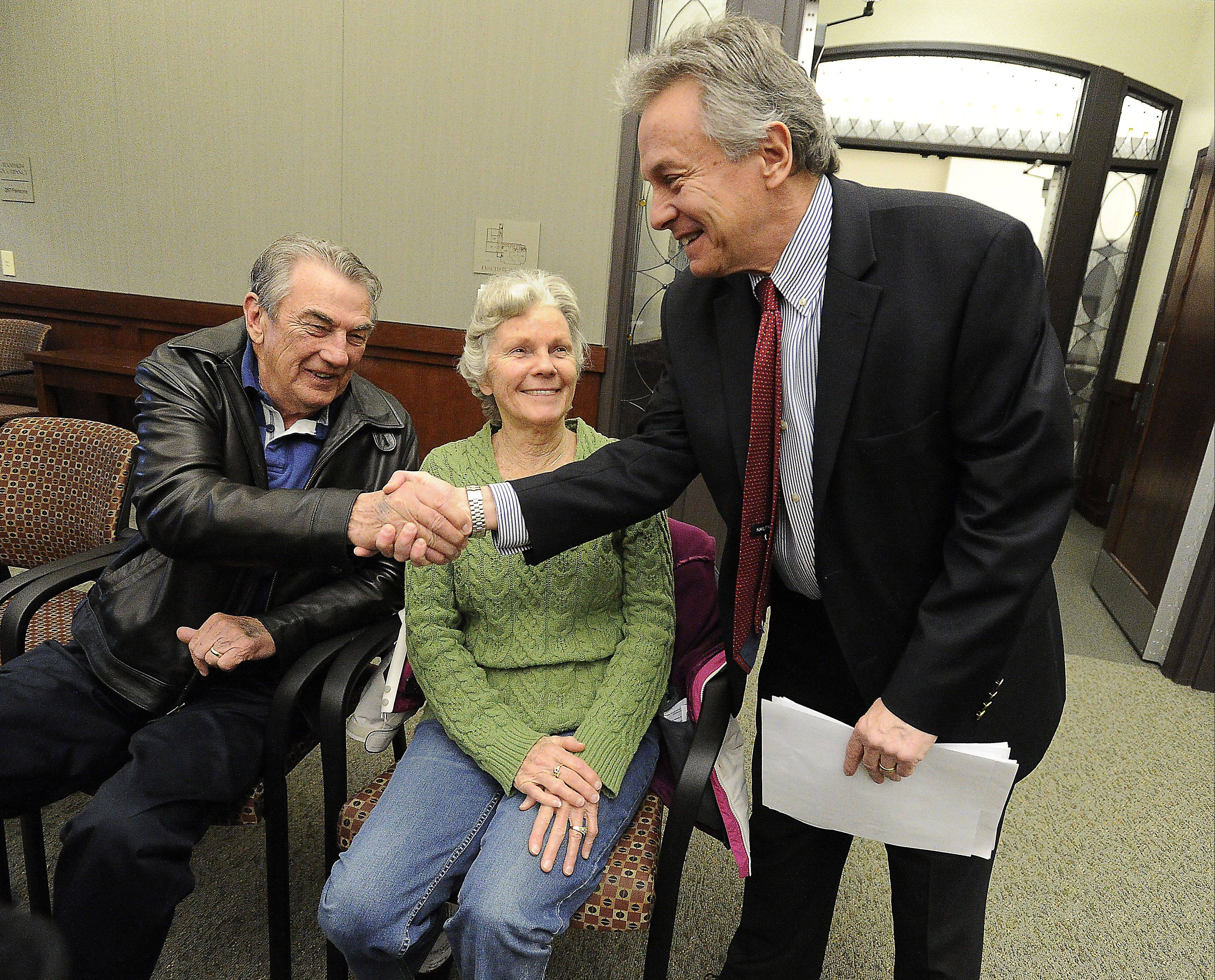 Mayoral candidate Mark Hellner greets Terry and Jean O'Connor before the League of Women Voters candidates forum on March 16.