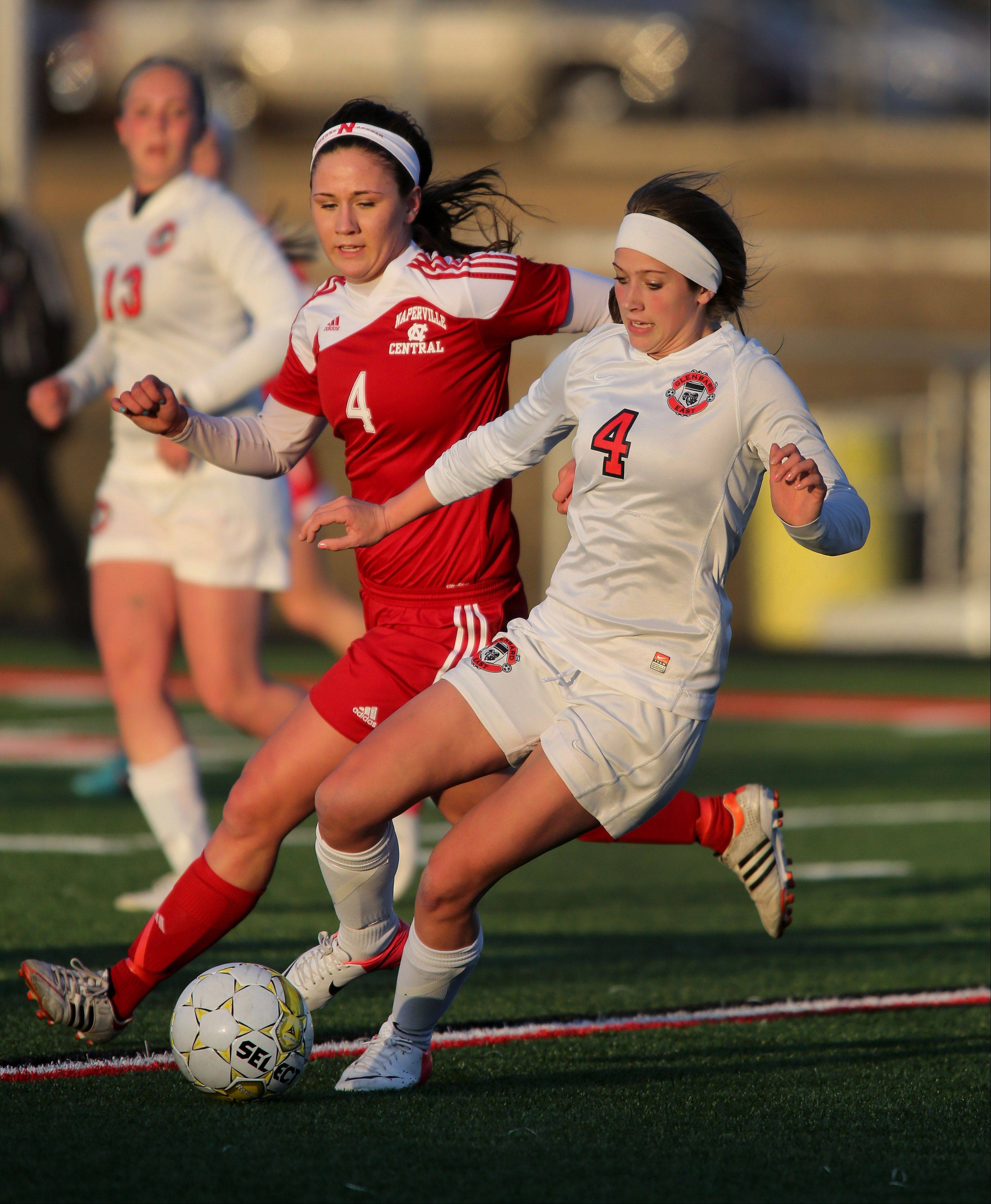 Ellie Fricke, left, of Naperville Central, moves in, but Alex Ruffer of Glenbard East takes control of the ball during girls soccer on Tuesday in Lombard.