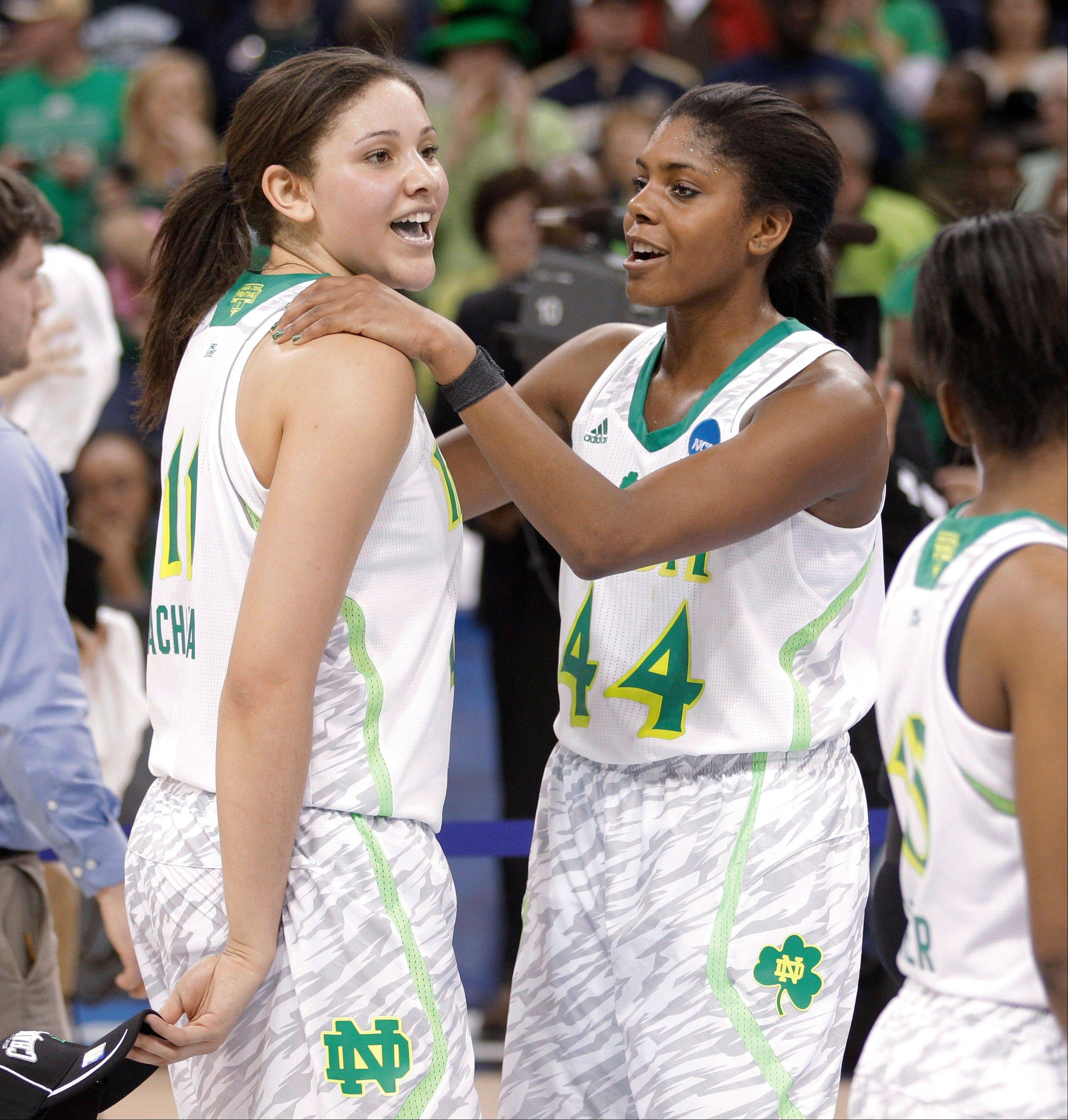 Notre Dame forwards Natalie Achonwa (11) and Ariel Braker (44) celebrate Notre Dame's win over Duke at the regional final of the NCAA women's college basketball tournament Tuesday, April 2, 2013, in Norfolk, Va. Notre Dame won 87-76. (AP Photo/Steve Helber)