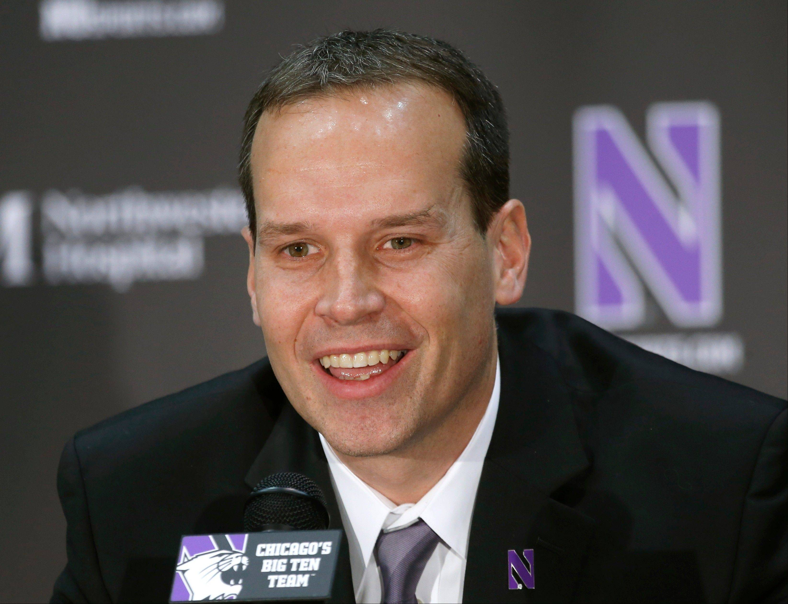 Chris Collins, Northwestern�s new basketball coach, responds to a question at Tuesday morning�s news conference.