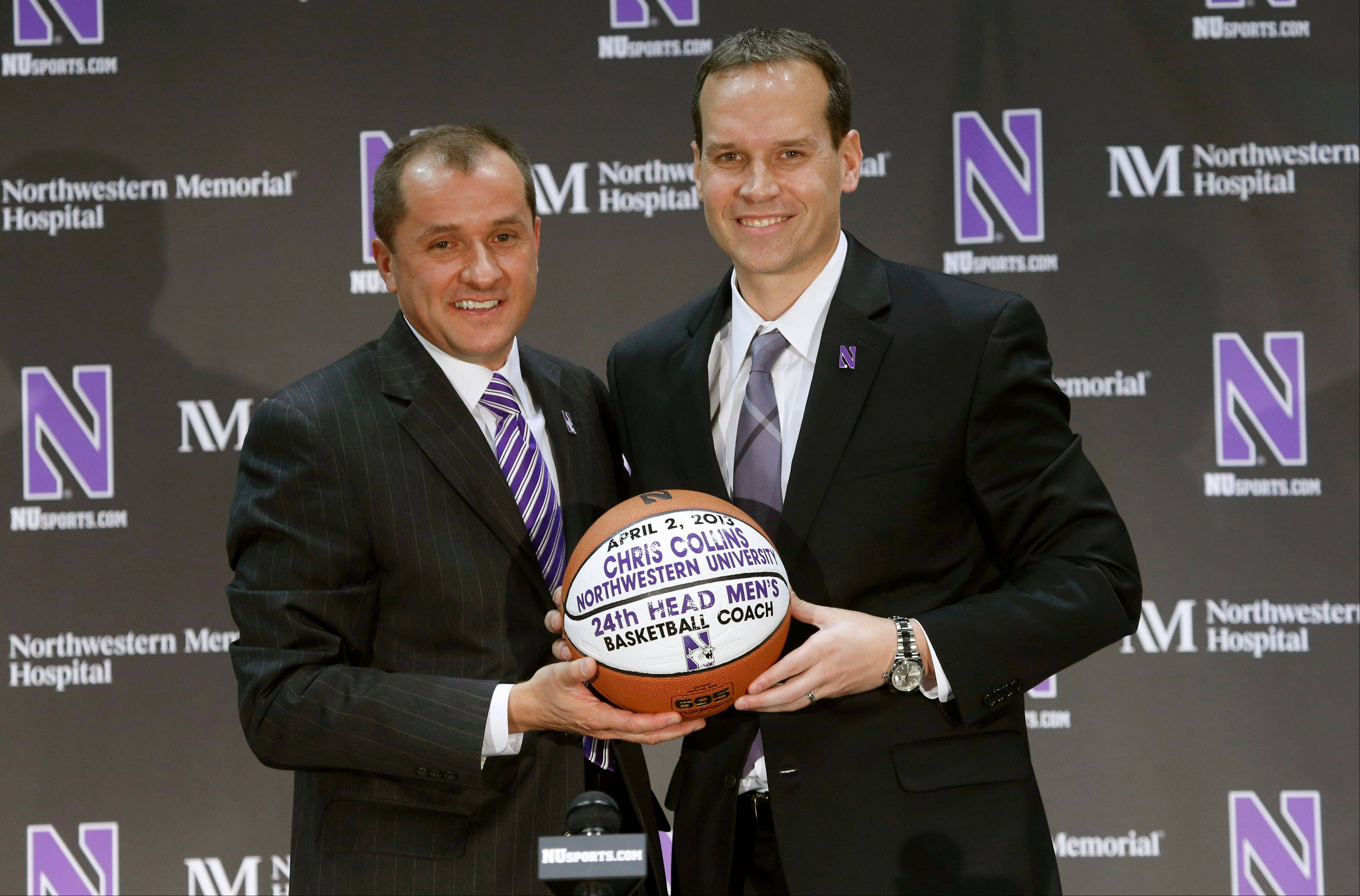 Northwestern University Athletic Director Jim Phillips, left, stands with former Duke University assistant coach Chris Collins after Phillips introduced Collins as the new head men's basketball coach at Northwestern during a news conference Tuesday, April 2, 2013 in Evanston, Ill. (AP Photo/Charles Rex Arbogast)