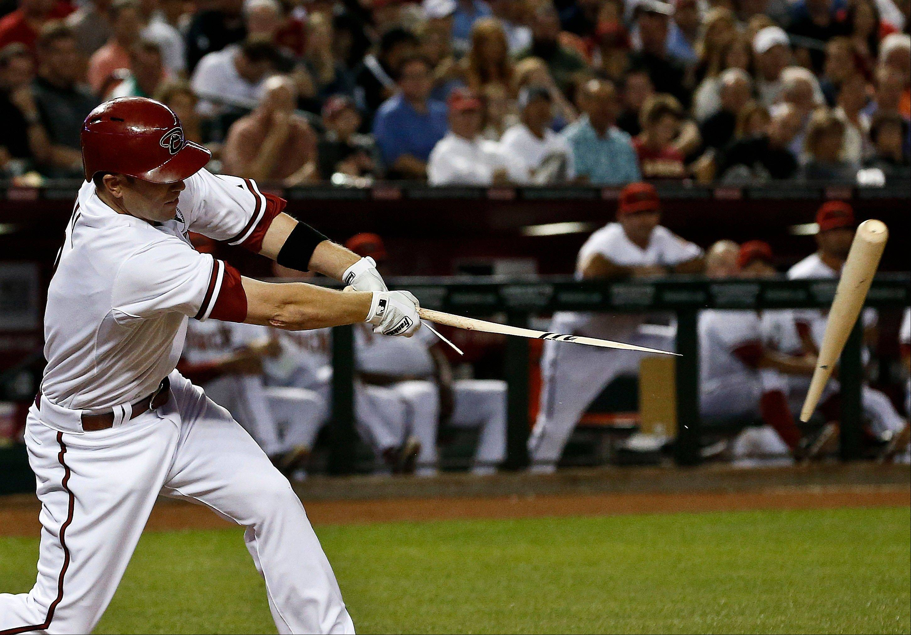 The Diamondbacks� Aaron Hill breaks his bat but connects for an RBI hit against the St. Louis Cardinals in the fifth inning Monday on Opening Day in Phoenix.