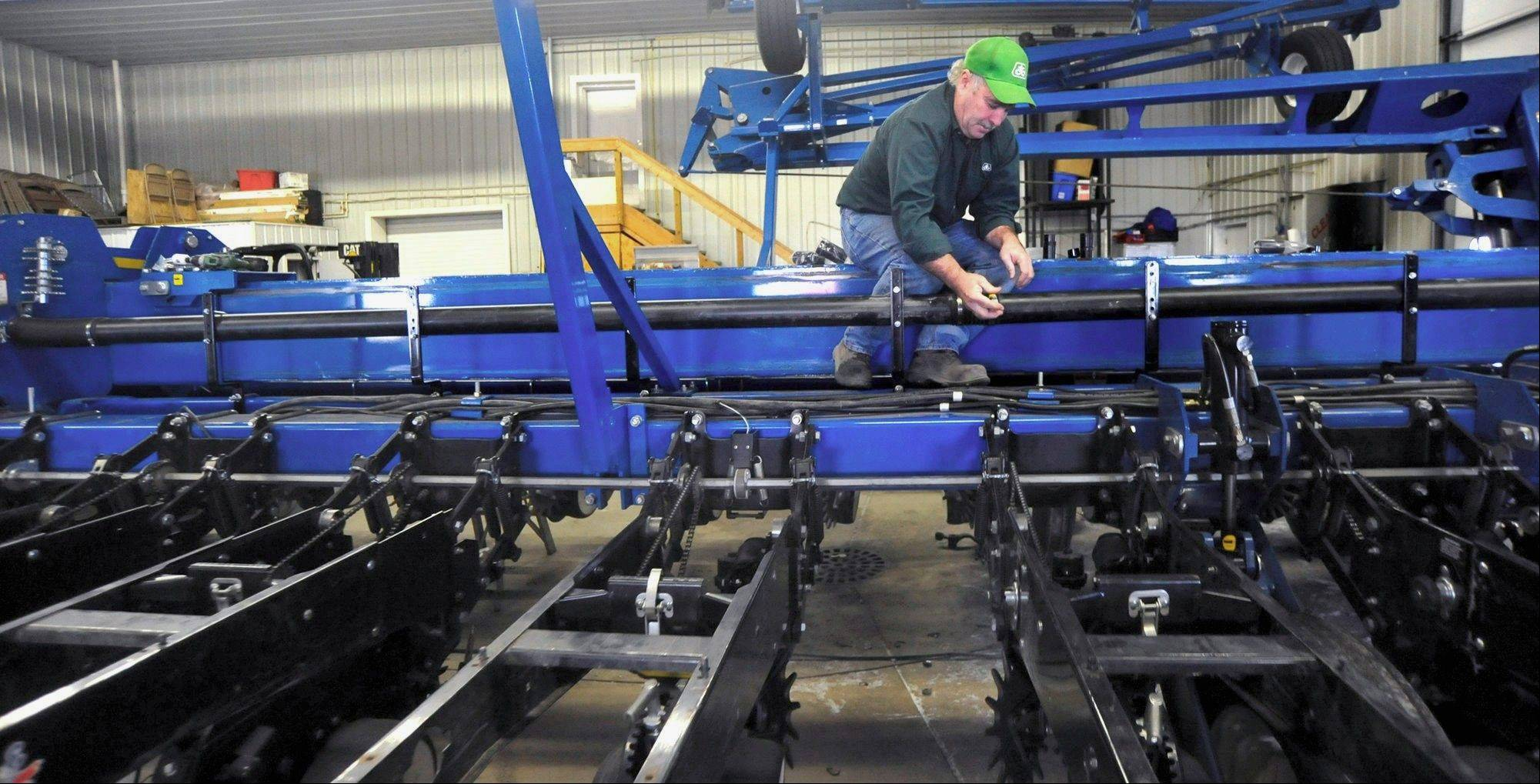 Farmer Jack Murray works on a planter on his farm in rural Champaign.