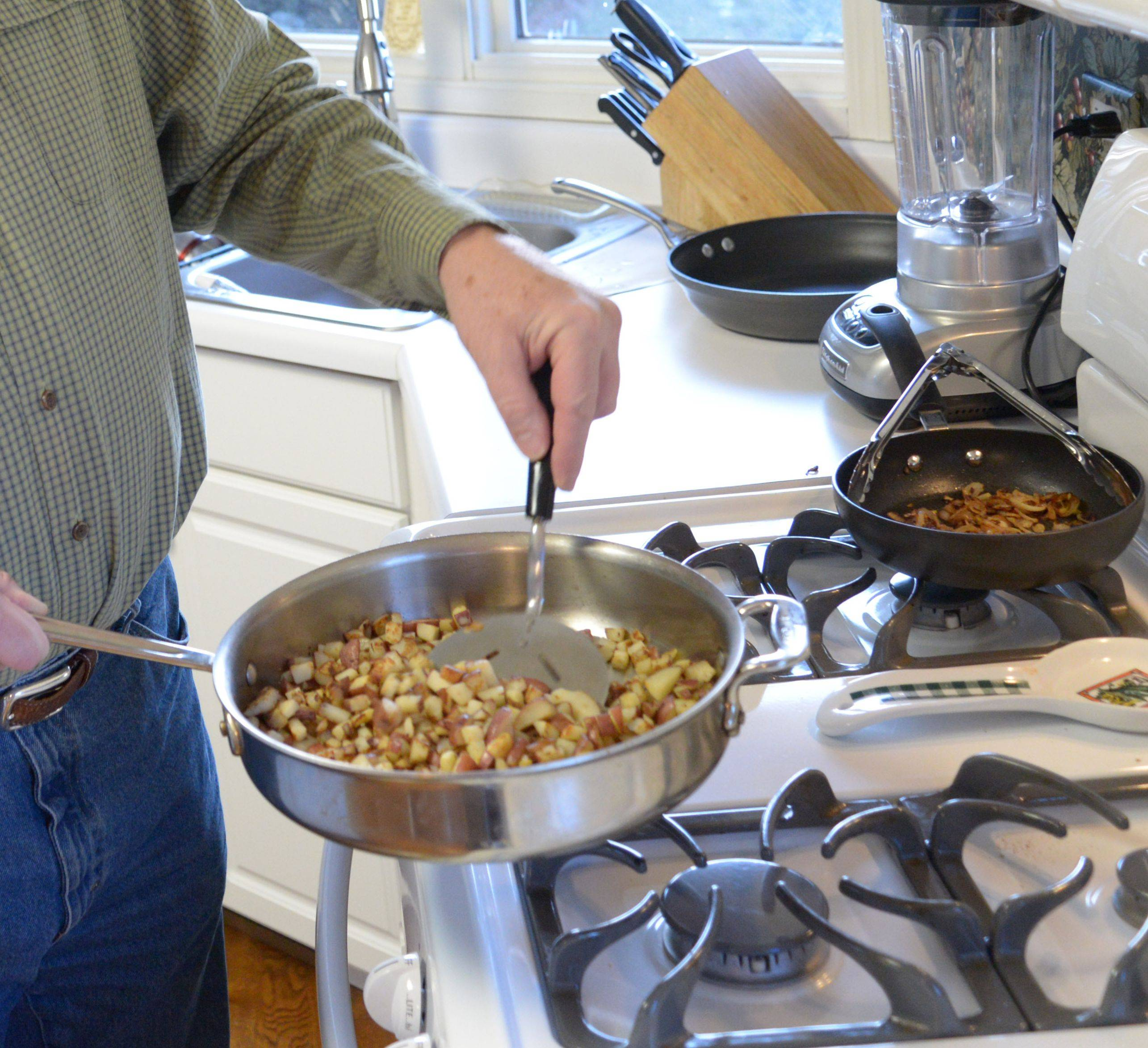 Tim Sullivan cooks fresh-cut potatoes for his skillet breakfast.