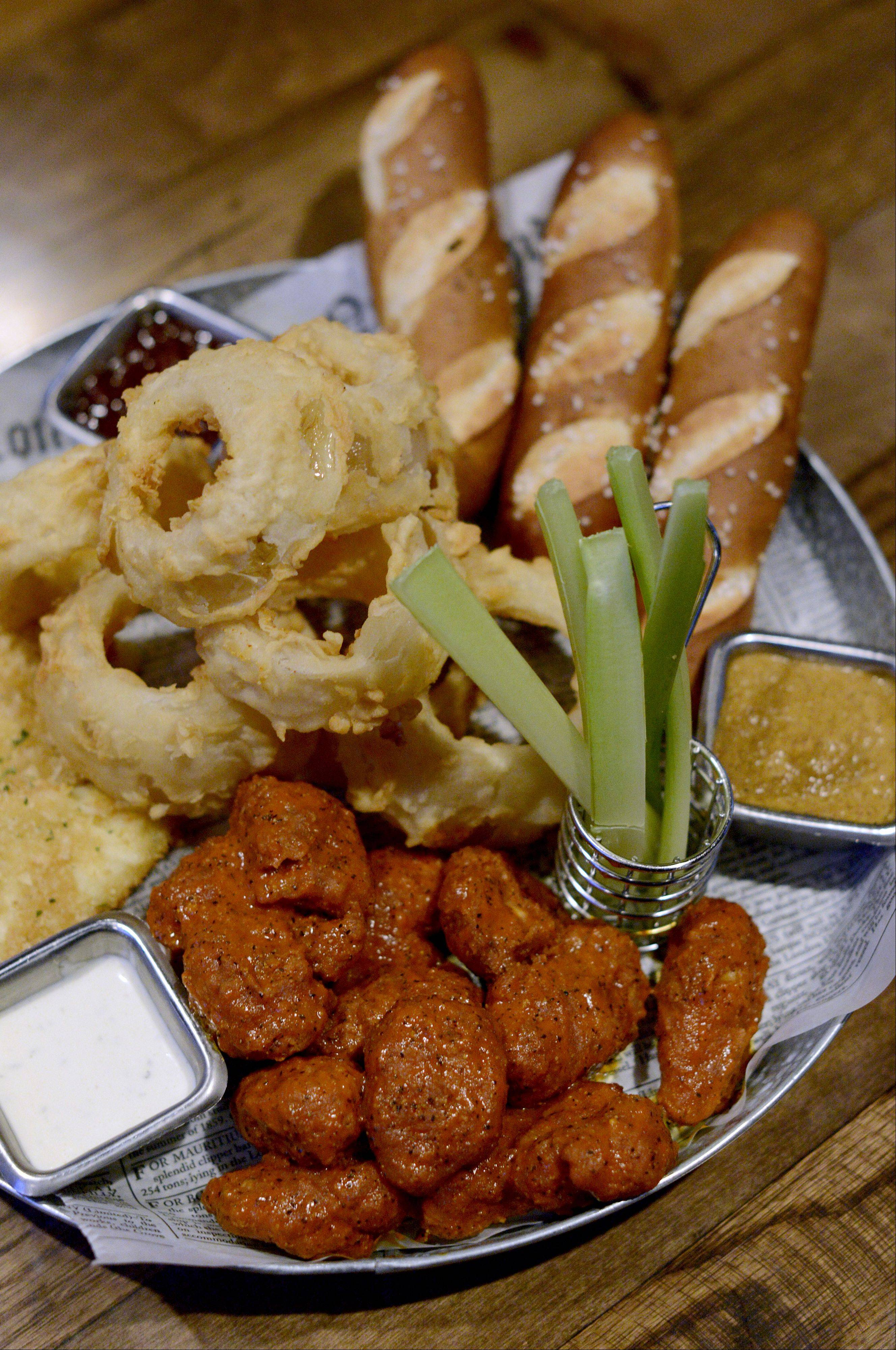 "Boneless tavern wings, ""Jacked-Up"" cheese wedges, pretzel sticks and onion rings team up with a trio of sauces for the Play-Action Platter served at the Fox & Hound Sports Tavern in Arlington Heights."