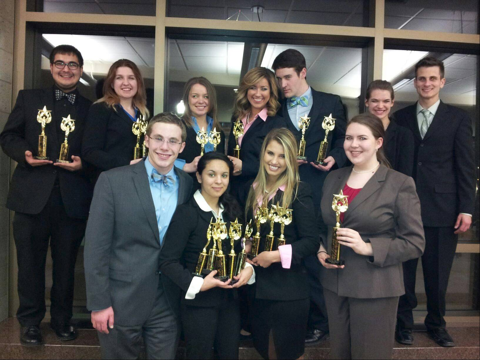 The 2012-13 Harper College Debate Team. Back row, from left: Miguel Melgar; Brianna Bitout; Melissa Bleile; Jackie Van LyseBettens; Patrick Halpin; Kelli Halfman and Anthony Suchala; front row, from left: Andy Robinson; Elisa Galvan; Kate Fundarek and Bridie Damisch.