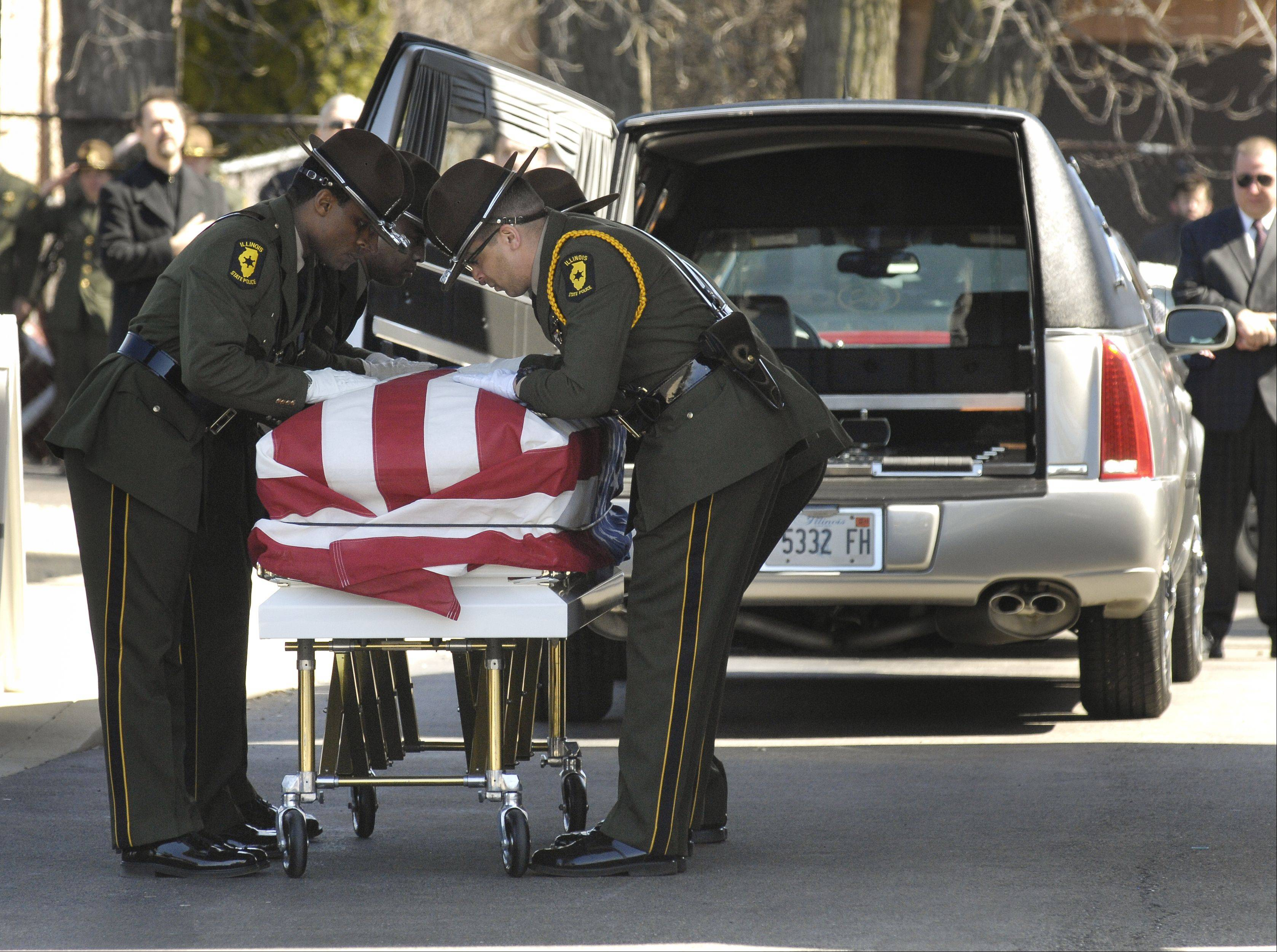 Fellow troopers carry the casket of fallen Illinois State Police Trooper James Sauter during his funeral service at Moraine Valley Church in Palos Heights Tuesday morning.