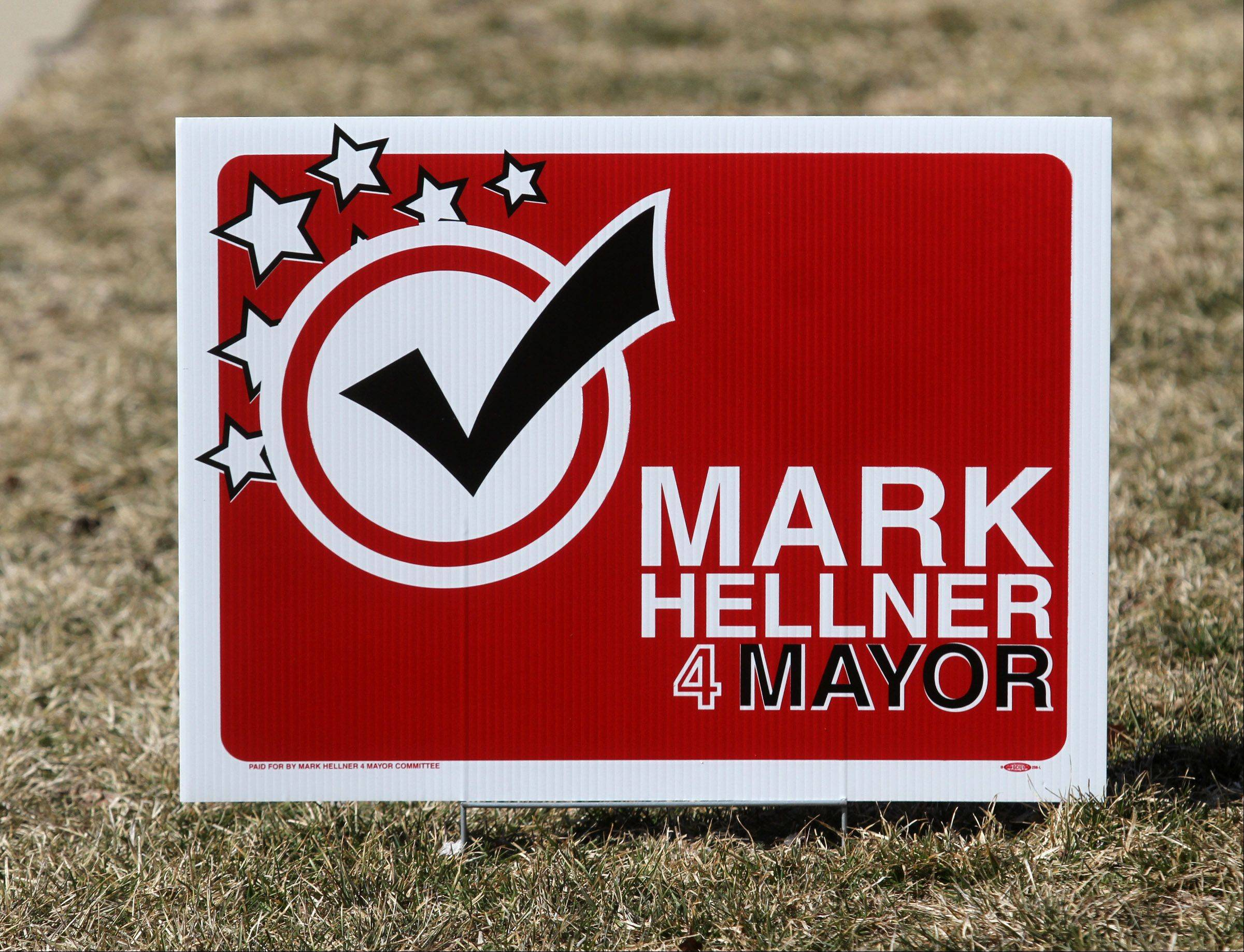 A campaign sign for Mark Hellner in an Arlington Heights lawn.