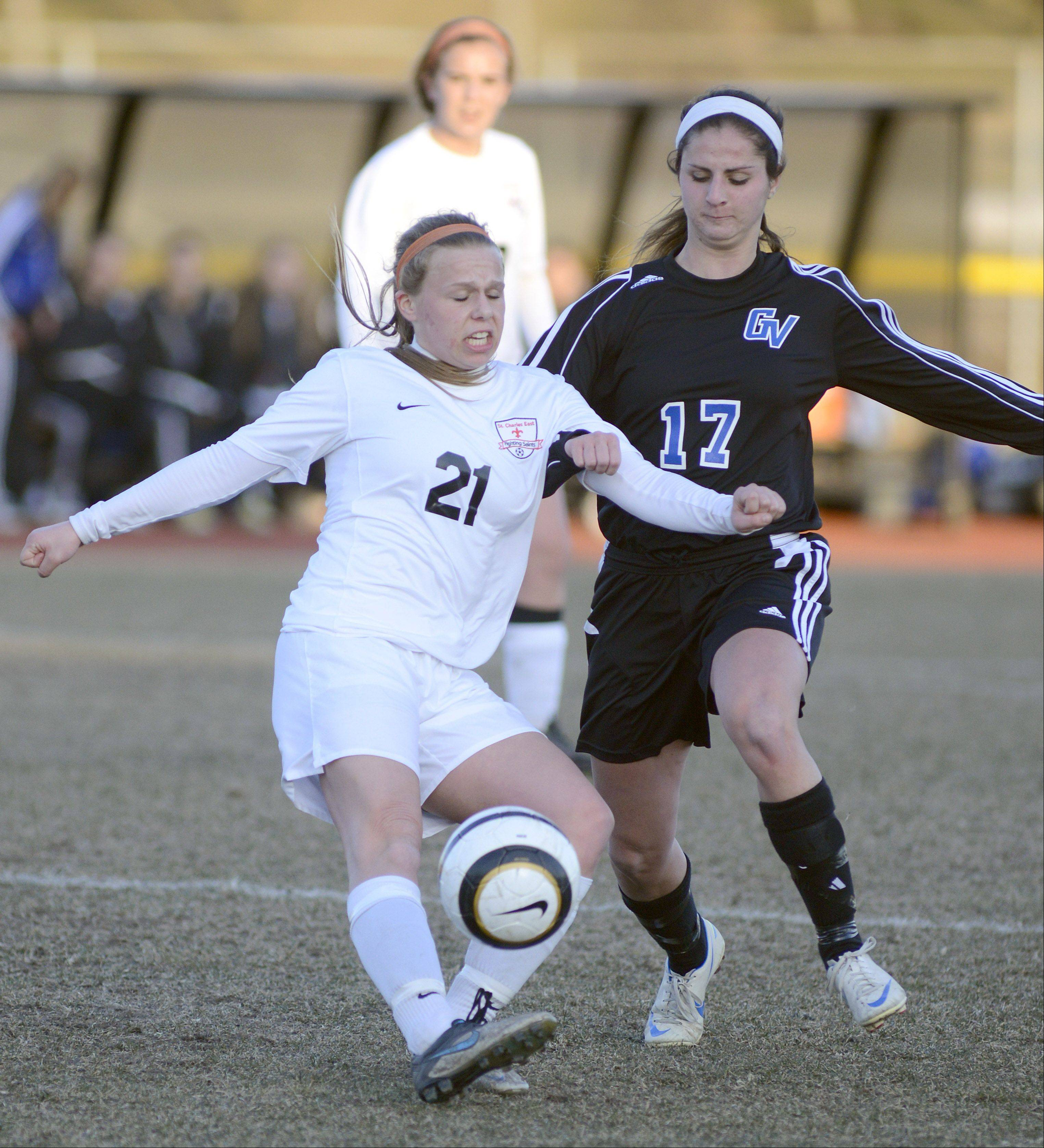 St. Charles East's Amanda Hilton and Geneva's Molly Axen battle for the ball in the first half on Tuesday, April 2.