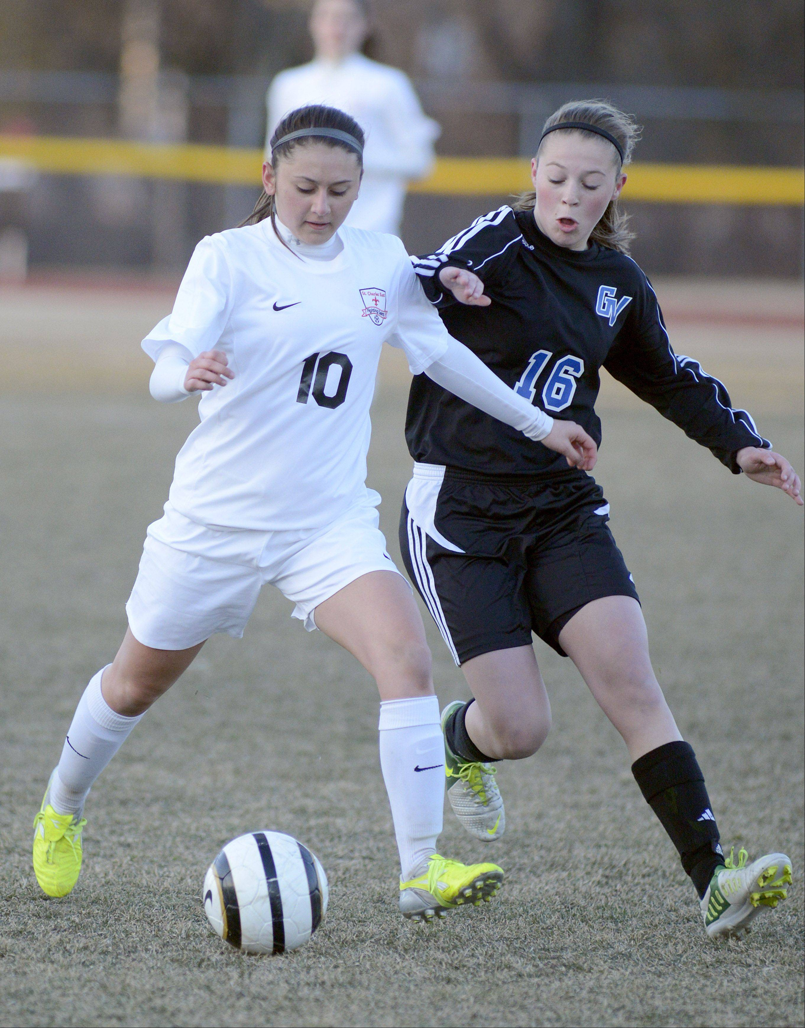 St. Charles East's Liana Imbrogno and Geneva's Maureen Kozlow battle for the ball in the first half on Tuesday, April 2.