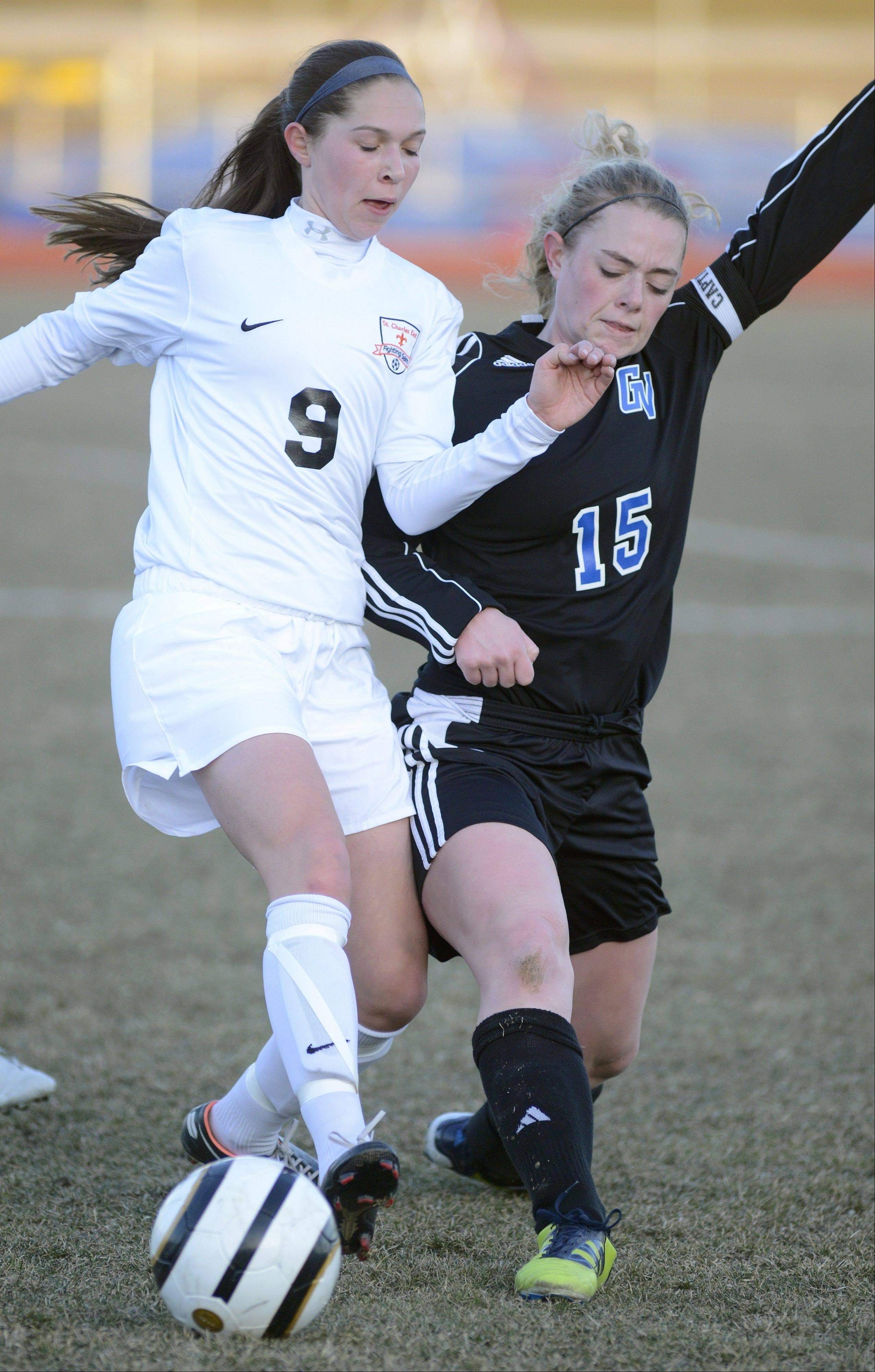 St. Charles East's Darcy Cunningham and Geneva's Annie Waldoch fight for the ball in the first half on Tuesday, April 2.