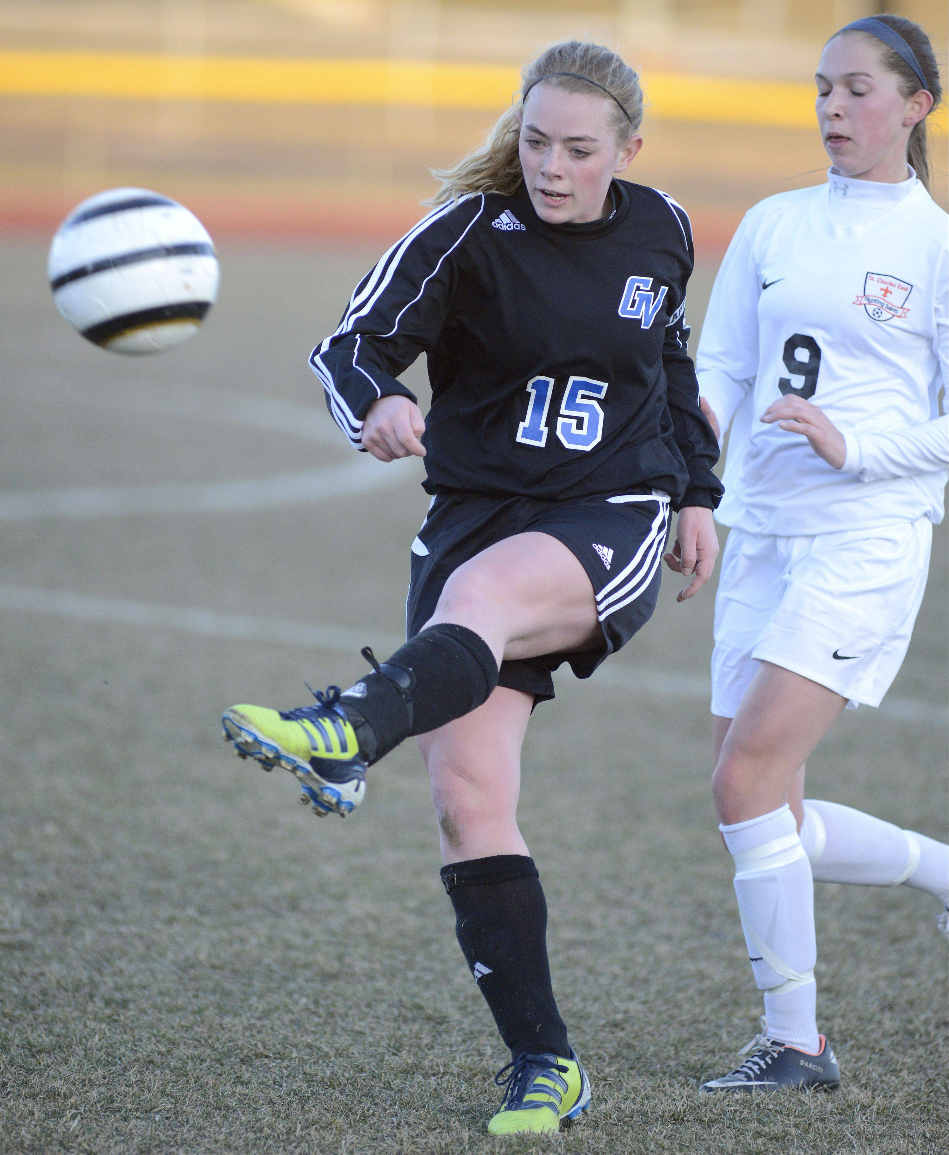 Geneva's Annie Waldoch kicks the ball before St. Charles East's Darcy Cunningham has a chance to invade in the first half on Tuesday, April 2.