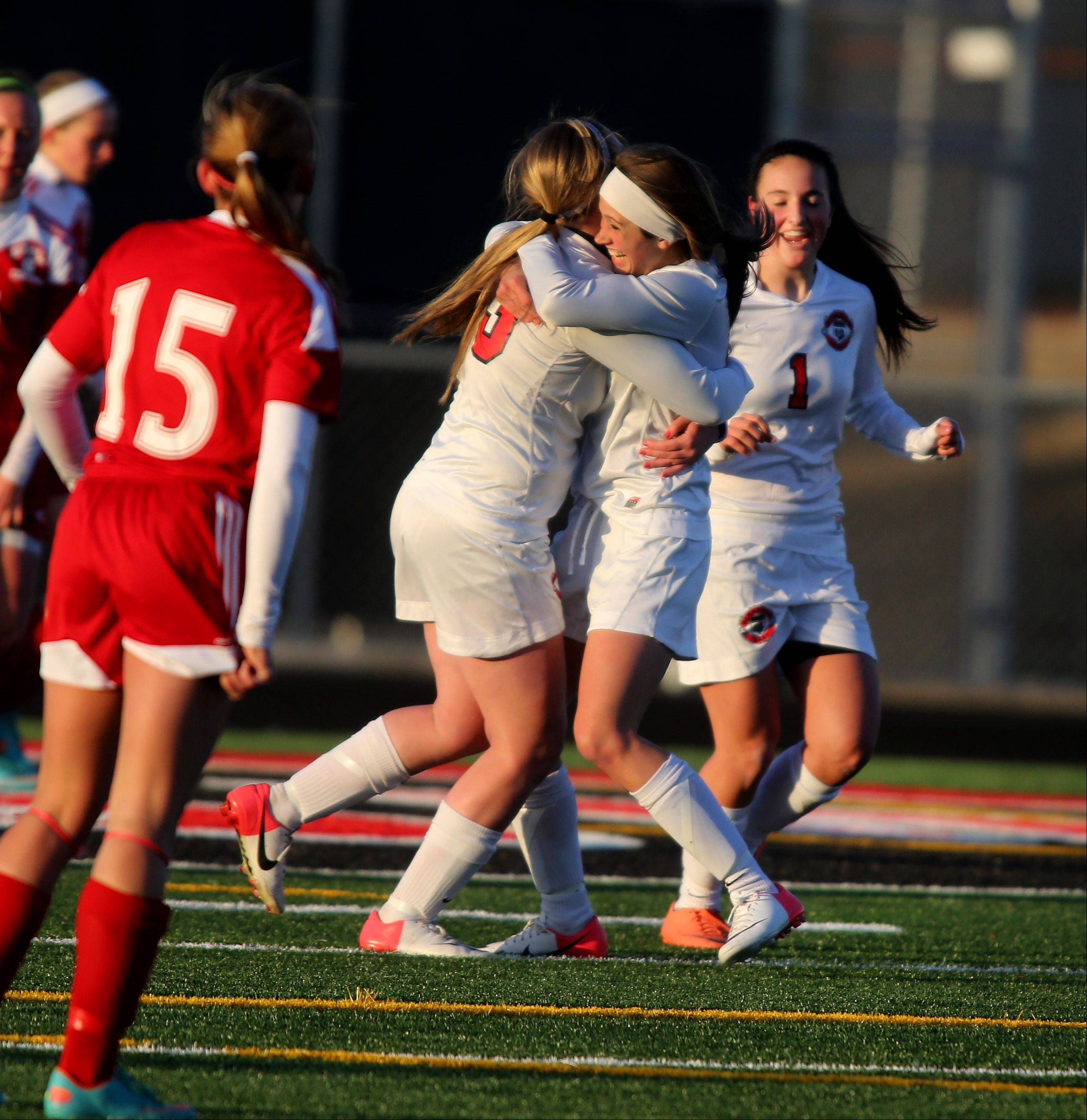 Alex Ruffer of Glenbard East, center, is congratulated by her teammates after making a goal in the first half against Naperville Central during girls soccer on Tuesday in Lombard.