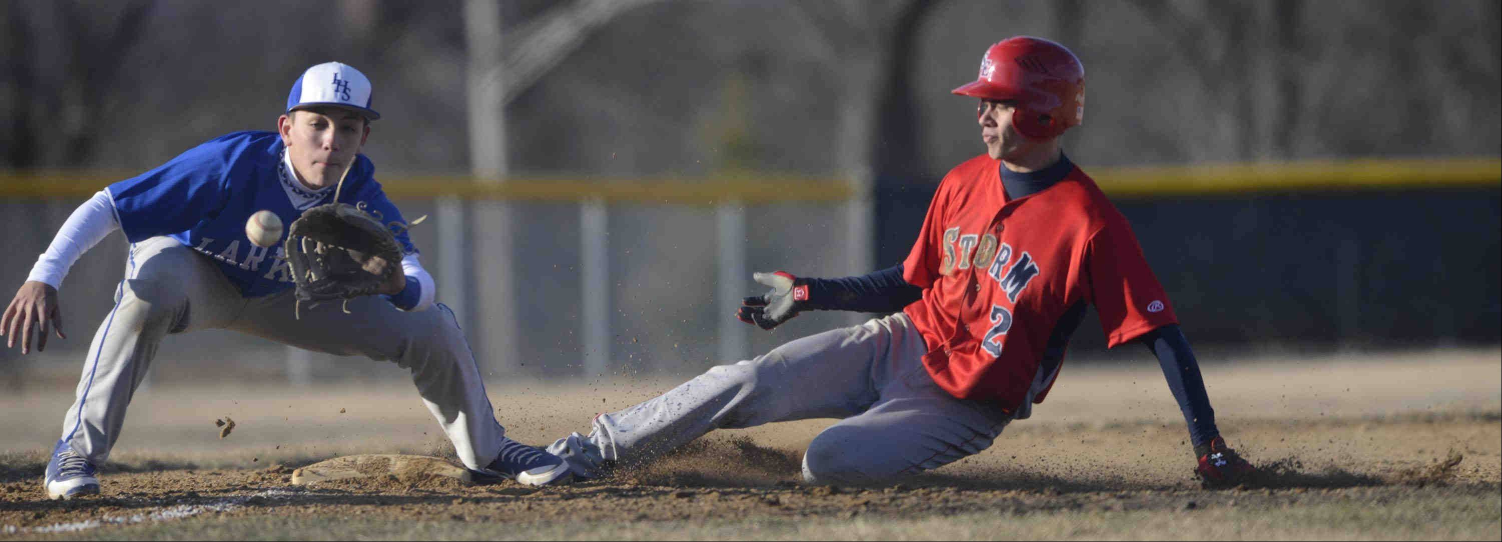 South Elgin's Tyler Christensen slides safely into the bag as Larkin third baseman Dan Lenz waits for the throw Tuesday in South Elgin.