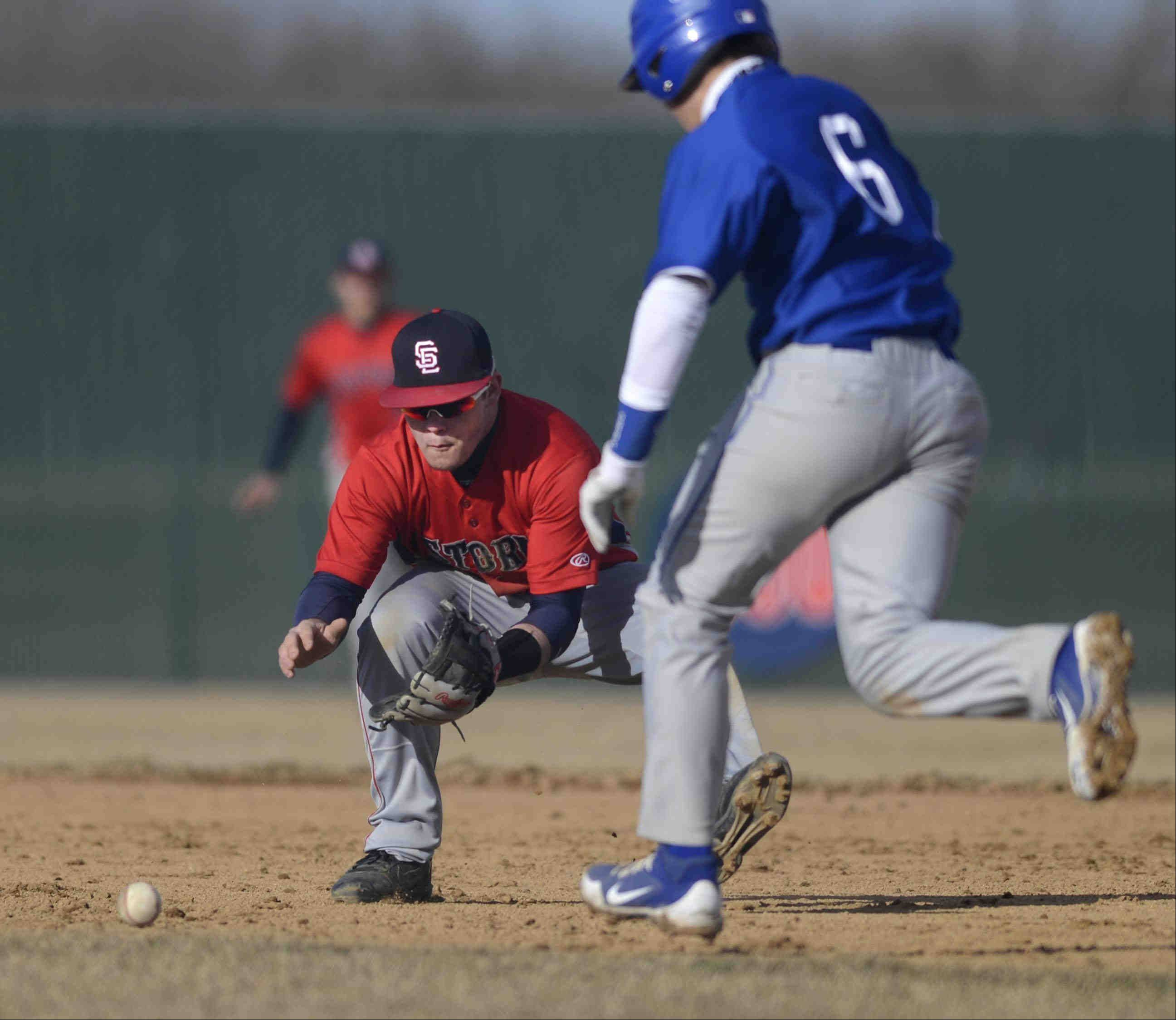 South Elgin second baseman Riley Halter concentrates on a ground ball by Larkin's Jack McCracken as Larkin baserunner Dan Lenz crosses his path in the second inning Tuesday in South Elgin. Halter made the play on McCracken.