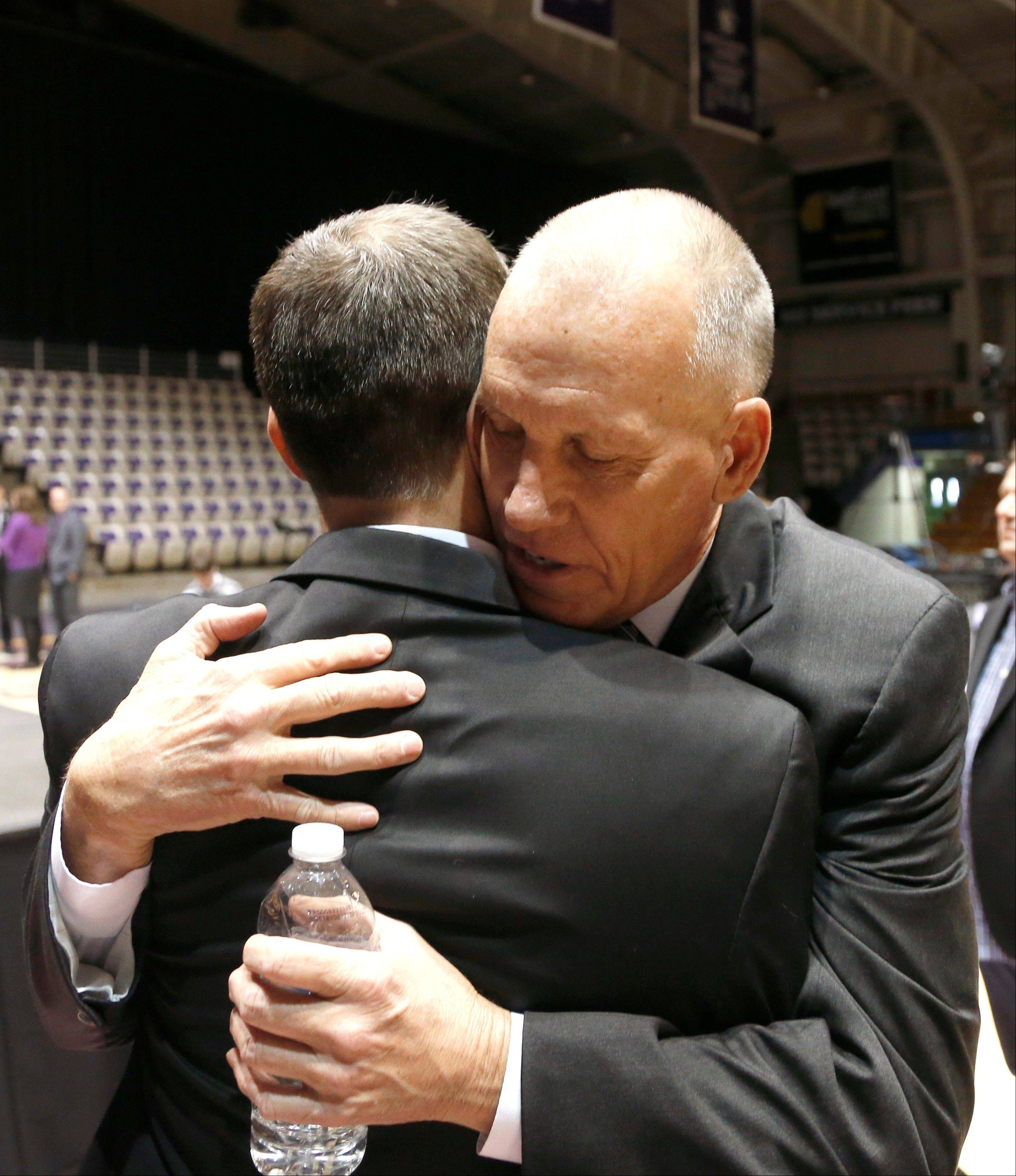 Philadelphia 76ers head coach Doug Collins, right, hugs his son Chris, after Chris was named the new men's head basketball coach at Northwestern University during a news conference Tuesday, April 2, 2013 in Evanston, Ill.