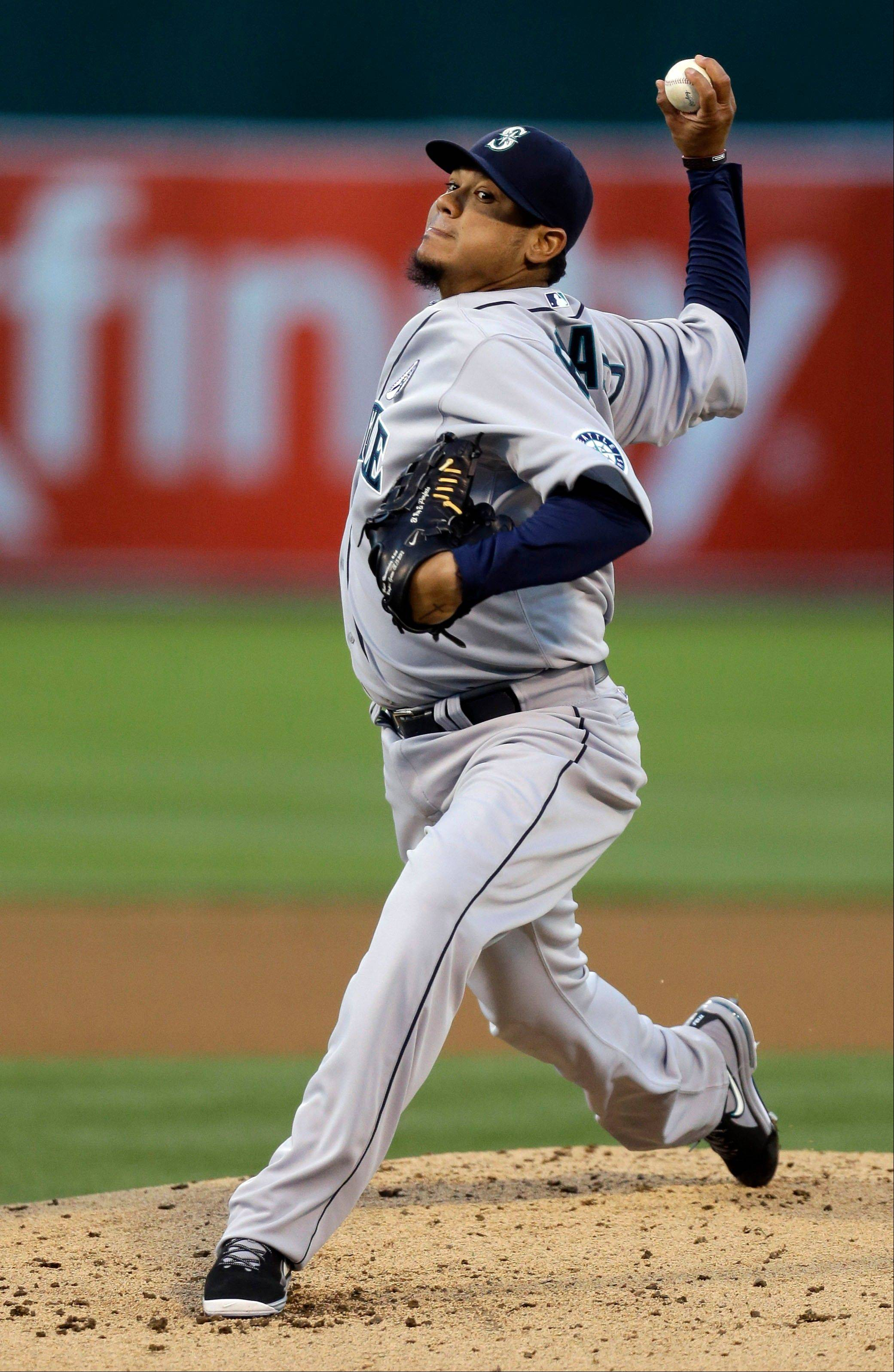 The Mariners' Felix Hernandez works against the Athletics in the first inning Monday in Oakland.