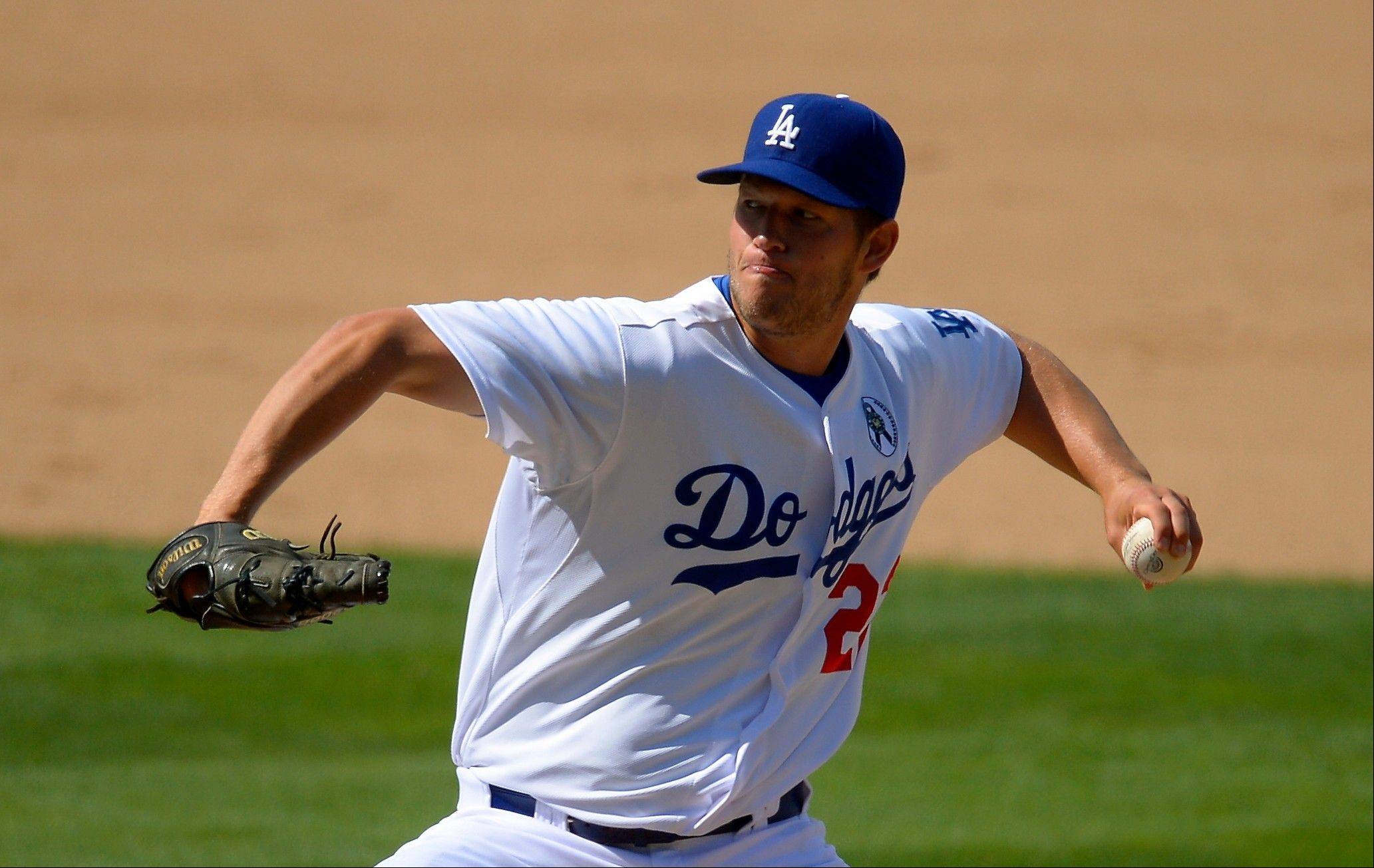 Dodgers starting pitcher Clayton Kershaw throws in the eighth inning Monday against the San Francisco Giants on Opening Day in Los Angeles.