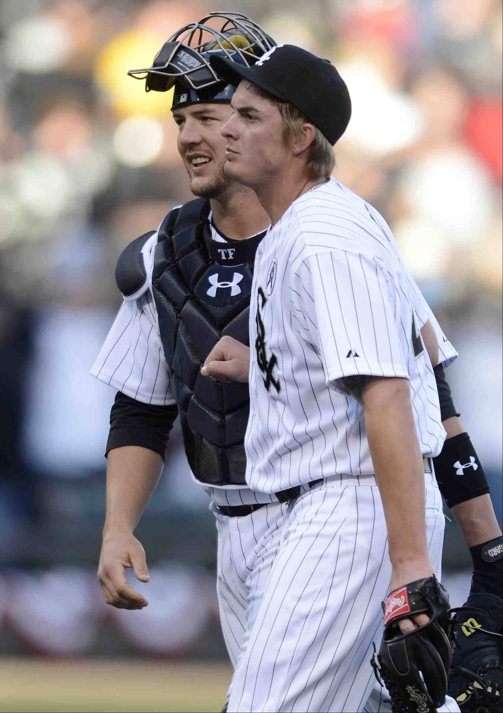 Catcher Tyler Flowers and closer Addison Reed walk off the field after the Chicago White Sox defeated the Kansas City Royals in the 2013 season opener at U.S. Cellular Field in Chicago.