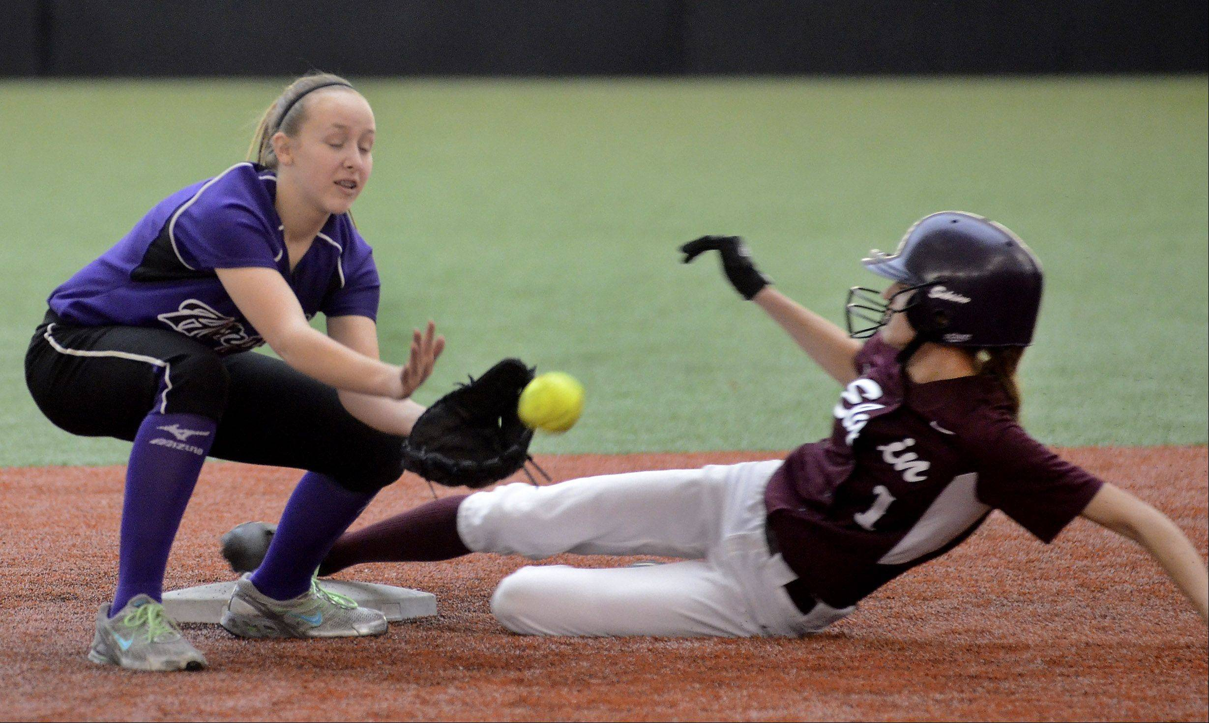 Elgin's Sabrina Stockman steals a base as Hampshire's Ally Snider covers during Monday's softball game.