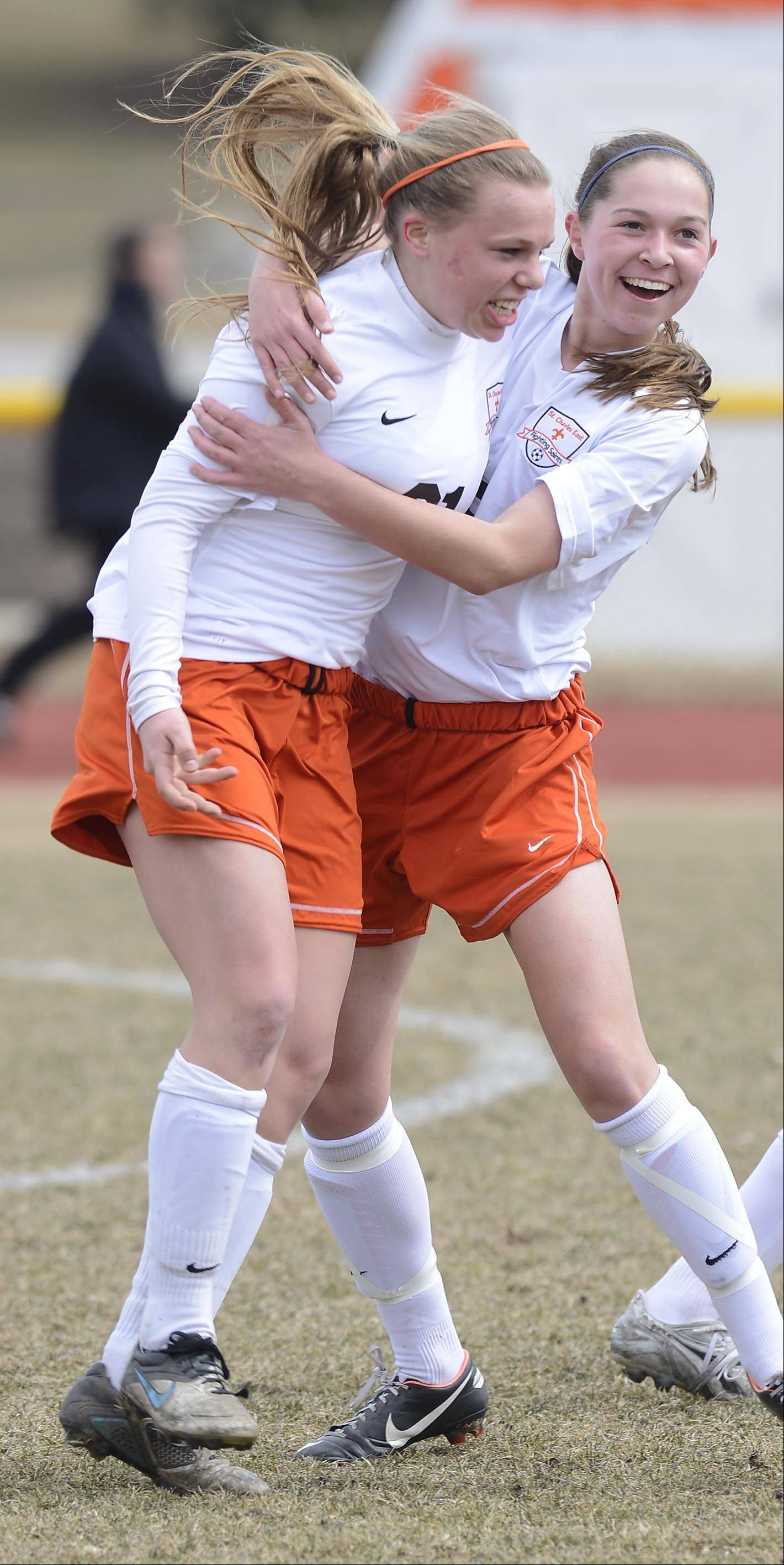 St. Charles East's Amanda Hilton, left, celebrates her goal with teammate Darcy Cunningham against Batavia Saturday.